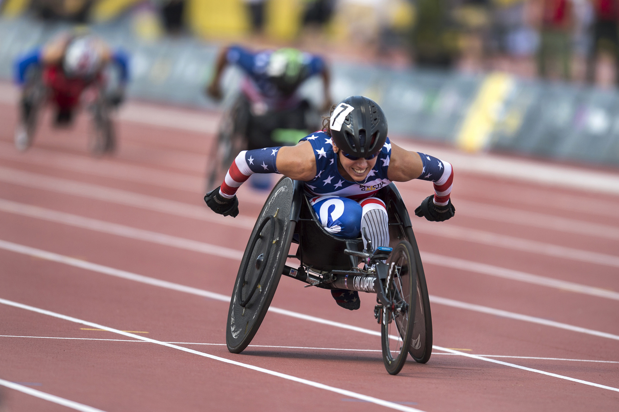 U.S. Army veteran Kelly Elmlinger races a wheelchair during the 2017 Invictus Games in Toronto, Canada, on Sept. 24, 2017. The Invictus Games, established by Prince Harry in 2014, brings together wounded and injured veterans from 17 nations for 12 adaptive sporting events, including track and field, wheelchair basketball, wheelchair rugby, swimming, sitting volleyball, and, new to the 2017 games, golf. (EJ Hersom/DoD)