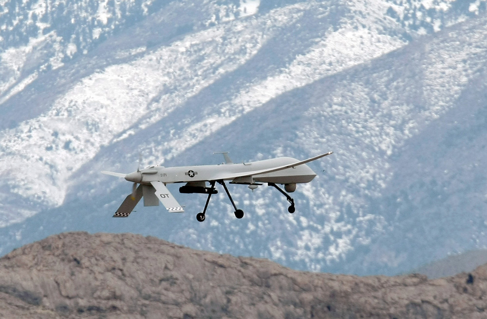 An MQ-1B Predator unmanned aircraft system flies during training at Creech Air Force Base, Nevada. (Ethan Miller/Getty Images)