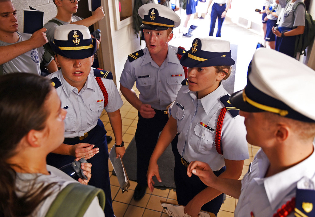 Whiskey Two company cadre, from left, Courtney McKenna, Joe Menesale, Kayla Apostolico and Mason Pagan confront a swab in the passageway as the U.S. Coast Guard Academy Class of 2022 reports in for Day 1 of Swab Summer on July 2, 2018, at the academy in New London, Conn. (Sean D. Elliot/The Day via AP)