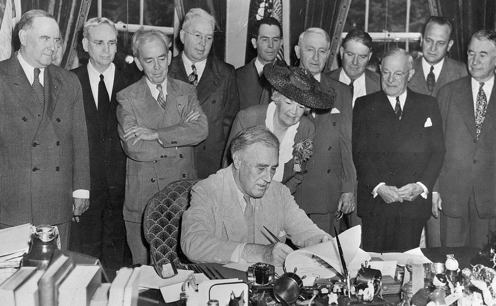 President Franklin Roosevelt signs what would become known as the GI Bill in his office June 22, 1944. (FDR Library Photo Collection)