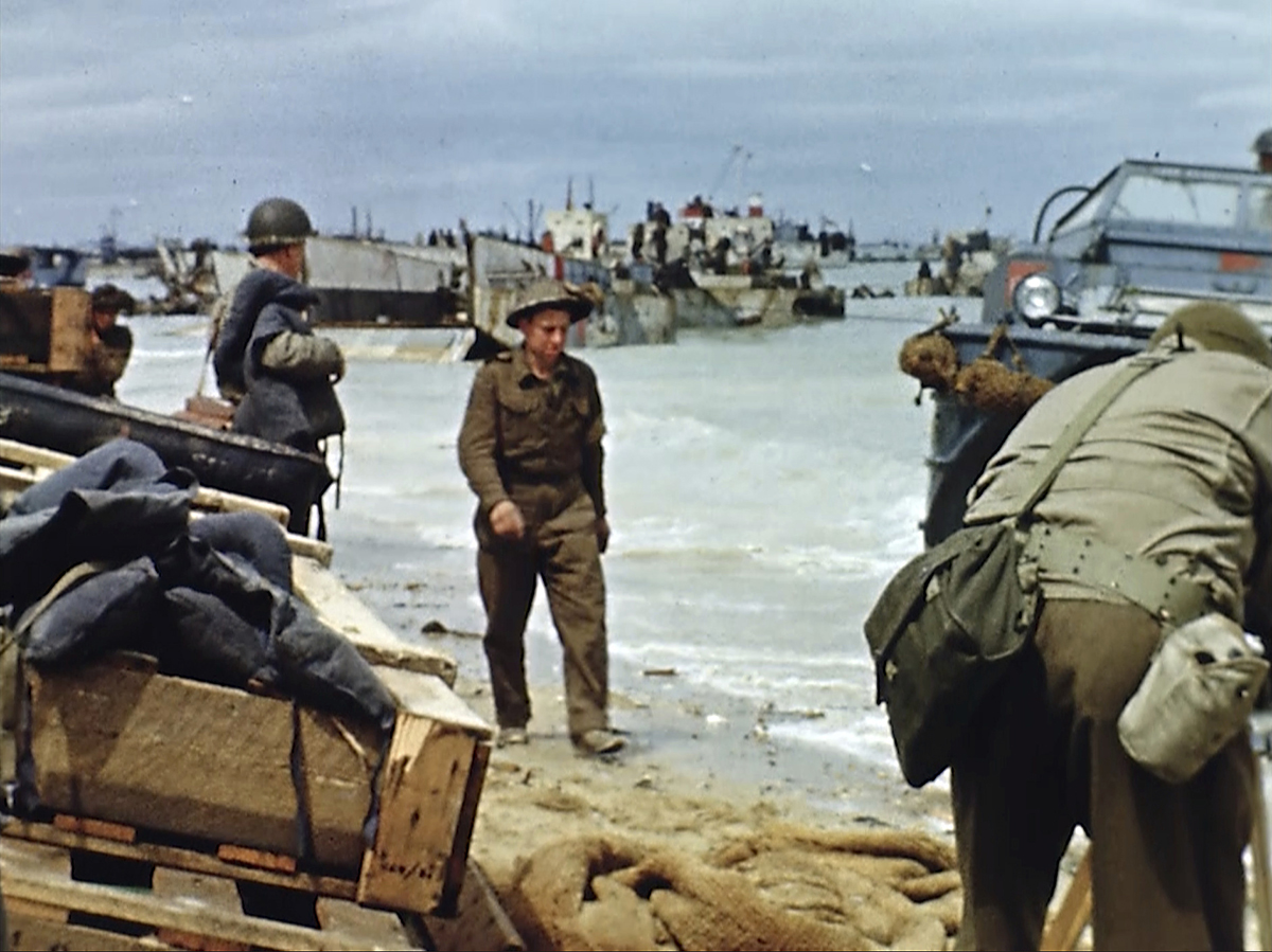 Landing craft on the beach during D-Day on June 6, 1944 in France. Seventy-five years later, surprising color images of the D-Day invasion and aftermath bring an immediacy to wartime memories. They were filmed by Hollywood director George Stevens and rediscovered years after his death. (War Footage From the George Stevens Collection at the Library of Congress via AP)