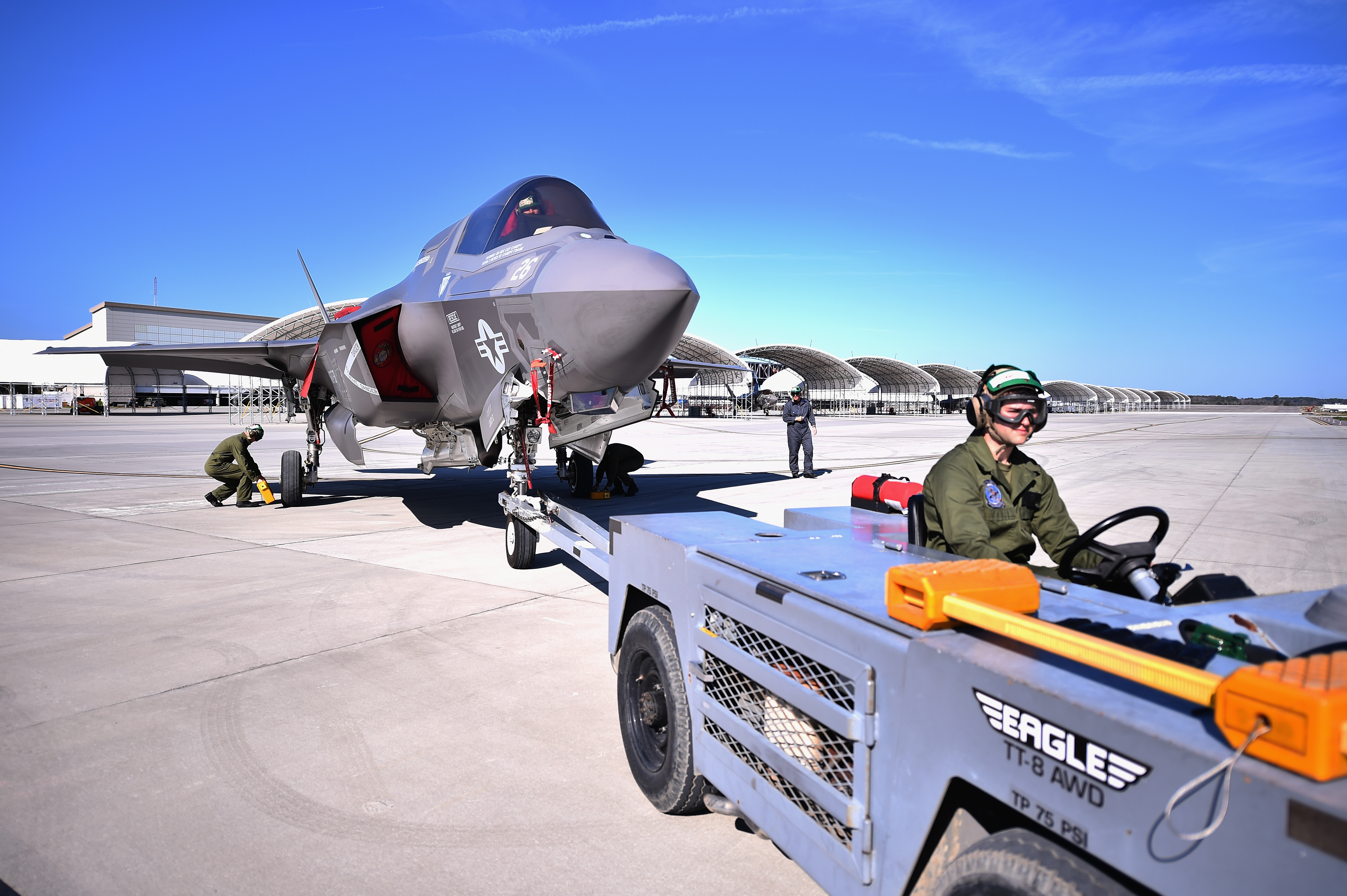 Ground crew maneuver the F-35B at Marine Corps Air Station Beaufort on March 8, 2016. UK personnel from the Royal Navy and Royal Air Force are embedded with the US Marine Corps on the F-35 operational training program, based in Beaufort, South Carolina. (Photo by Jeff J Mitchell/Getty Images)