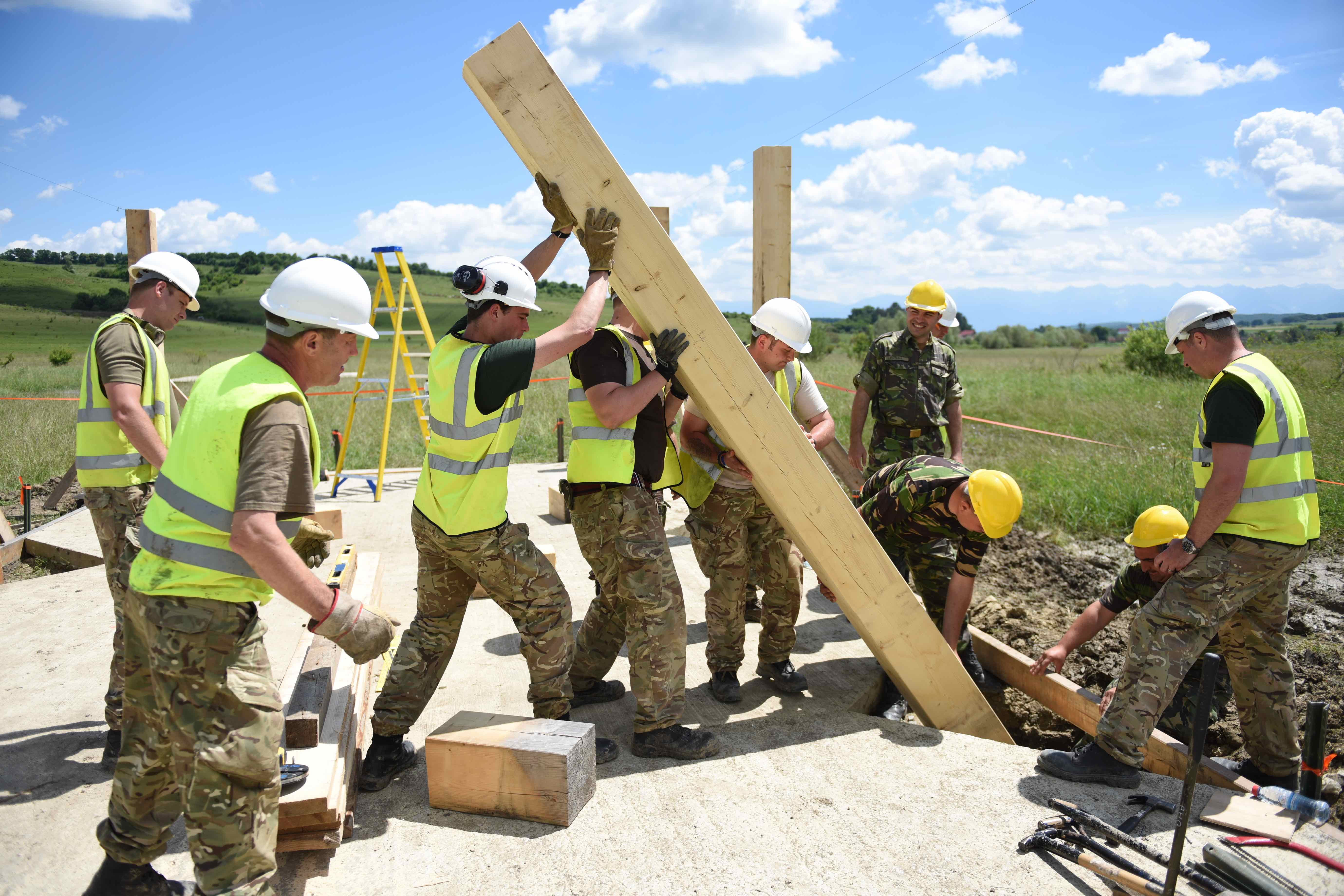 British Armed Forces and Romanian soldiers worked together to erect several buildings throughout the new training ranges, from a multipurpose shelter to a light demolition training range where soldiers can practice demolition of objects like doors and windows. Building the structures was no easy task considering the amount of rain during construction. Soldiers made fast work of sunny days. (Jen Judson/Staff)