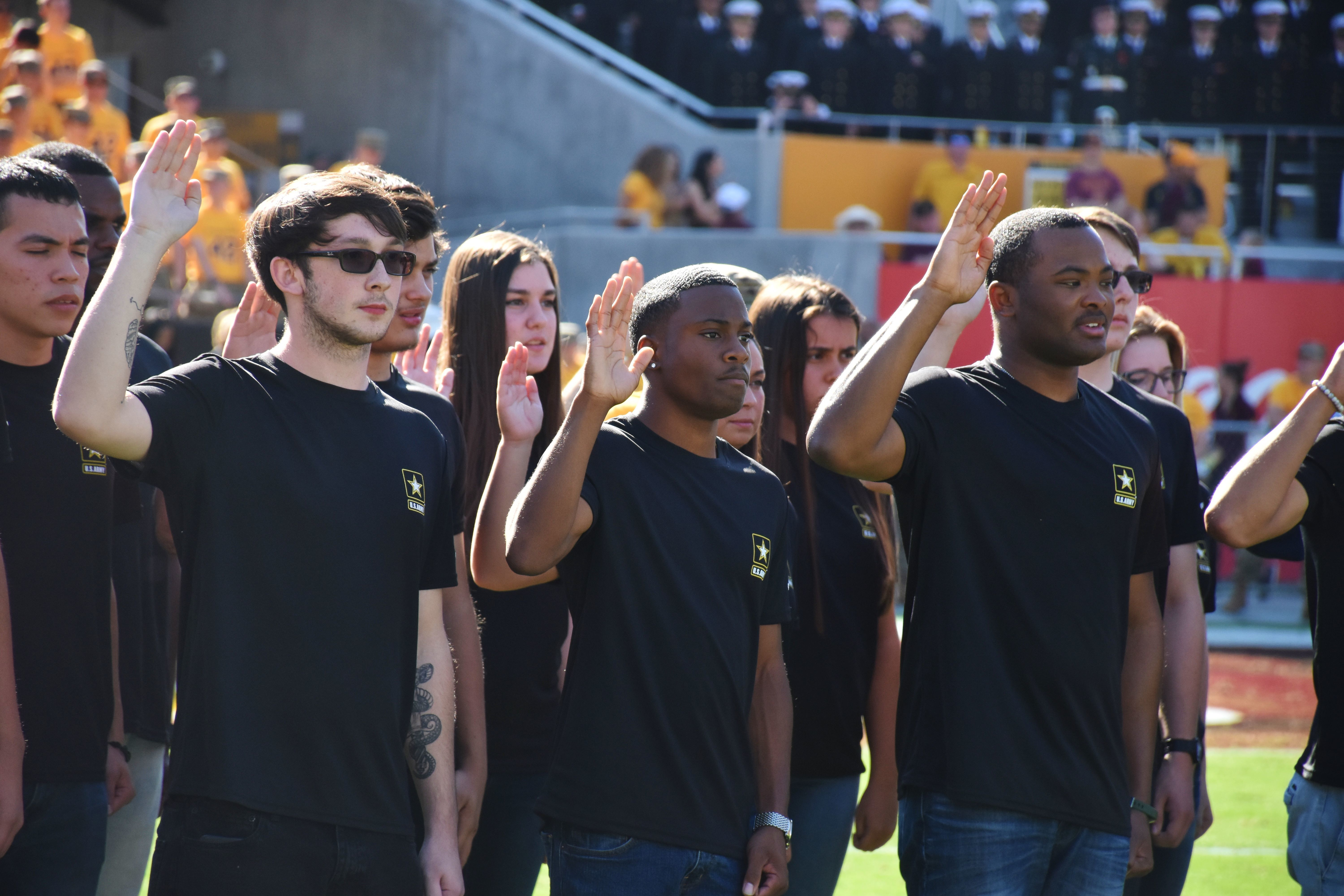 Future soldiers participate in a mass oath of enlistment ceremony during half-time at Arizona State University's Salute to Service college football game on Nov. 10, 2018, in Tempe, Arizona. (Alun Thomas/Army)