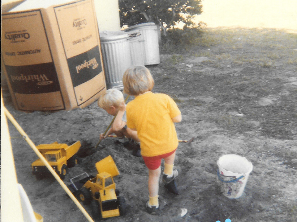 Kristen Emery's siblings play in the back of their military housing at Patrick Air Force Base in Florida. The kids liked to dig in the dirt, Emery said. (Courtesy of Kristen Emery)