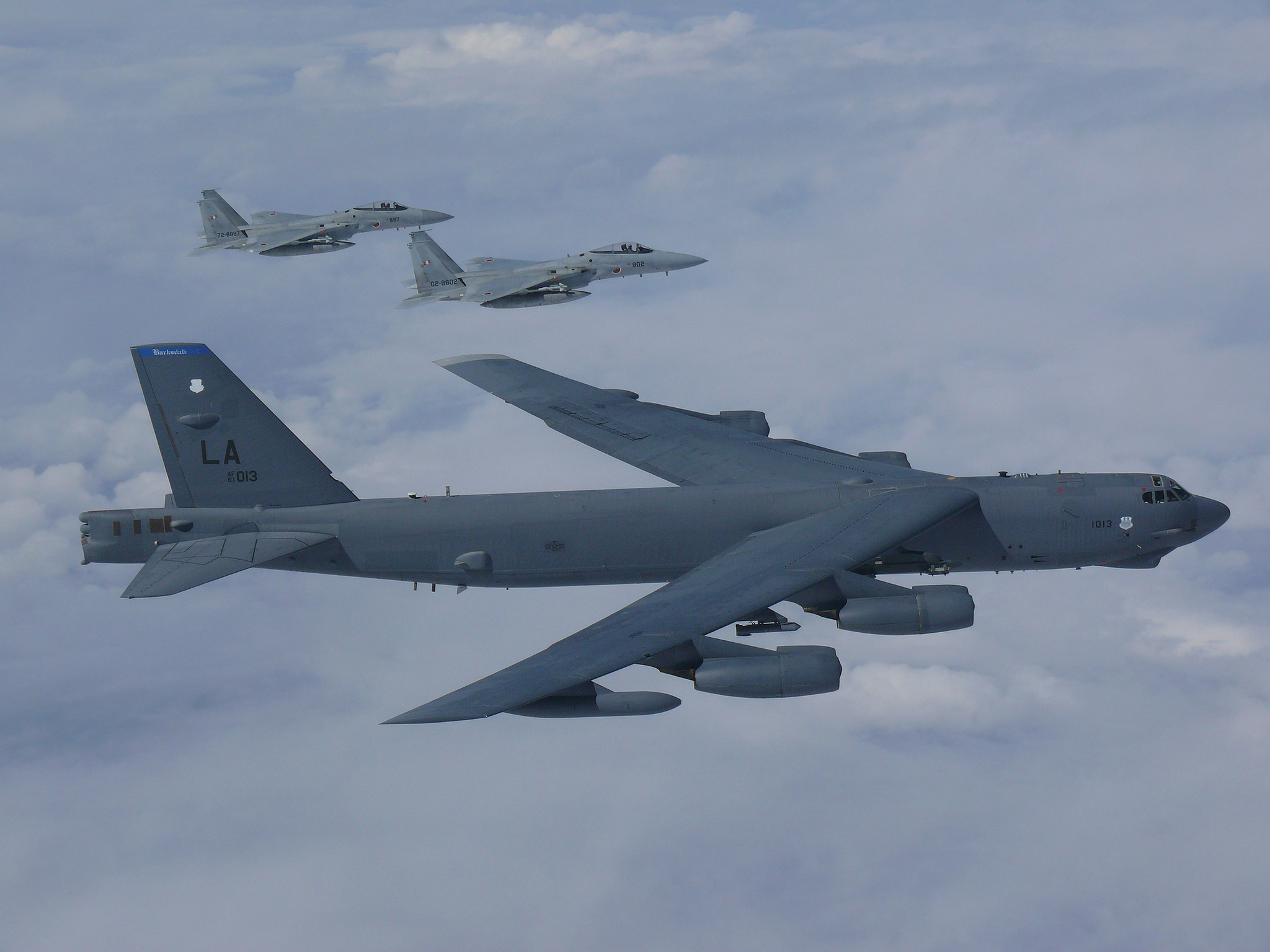 A U.S. Air Force B-52H Stratofortress bomber and two Koku Jieitai (Japan Air Self-Defense Force) F-15 fighters execute a routine bilateral training mission on Sept. 26, 2018, over the East China Sea and the Sea of Japan. This mission was flown in support of U.S. Indo-Pacific Command's continuous bomber presence operations, which are key to improving combined interoperability, tactical skills and relationships. These missions are consistent with international law and the United States' long-standing and well-known freedom of navigation policies. (USINDOPACOM)