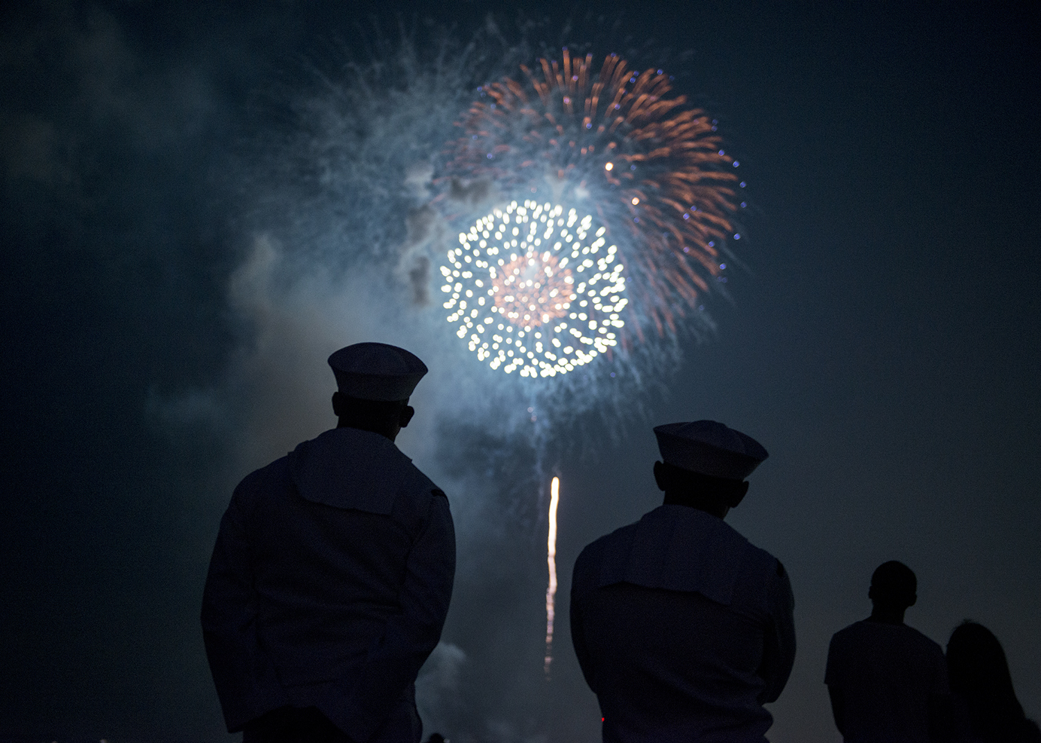Sailors enjoy fireworks during a celebration in Yokosuka, Japan in August 2019. (Garrett Zopfi/Navy)