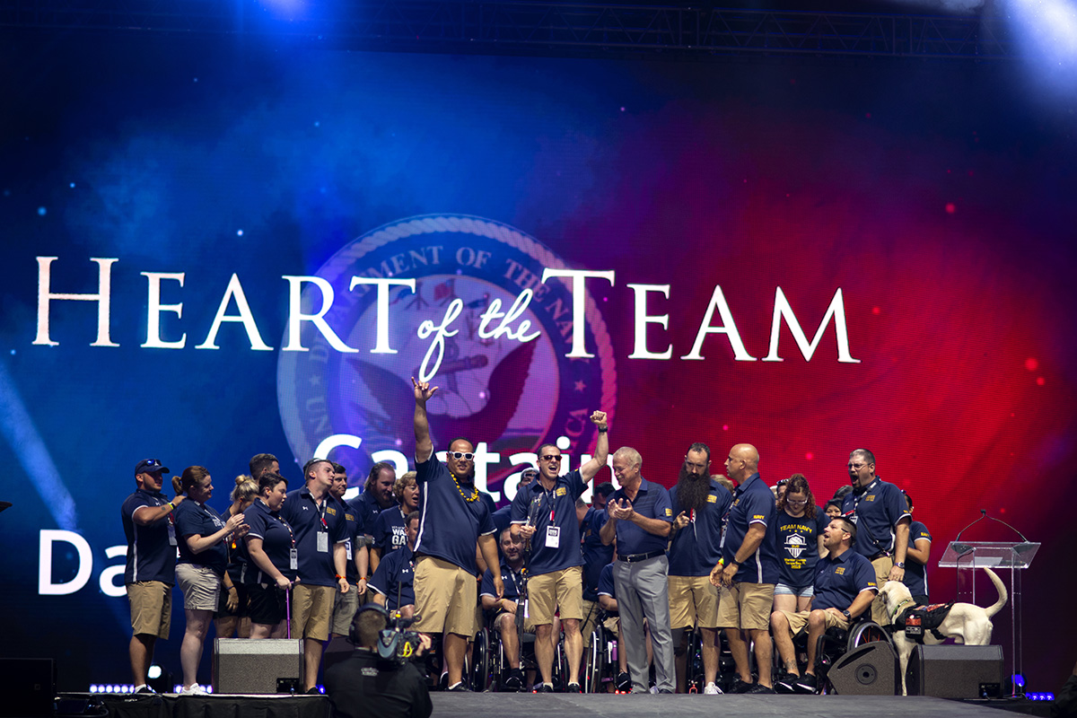 Coast Guard Capt. Daryl Schaffer, center, celebrates with Team Navy after being awarded the Heart of the Team award on June 30 during the closing ceremony of the 2019 DoD Warrior Games in Tampa, Fla. (Mass Communication Specialist 2nd Class Ethan T. Miller/Navy)