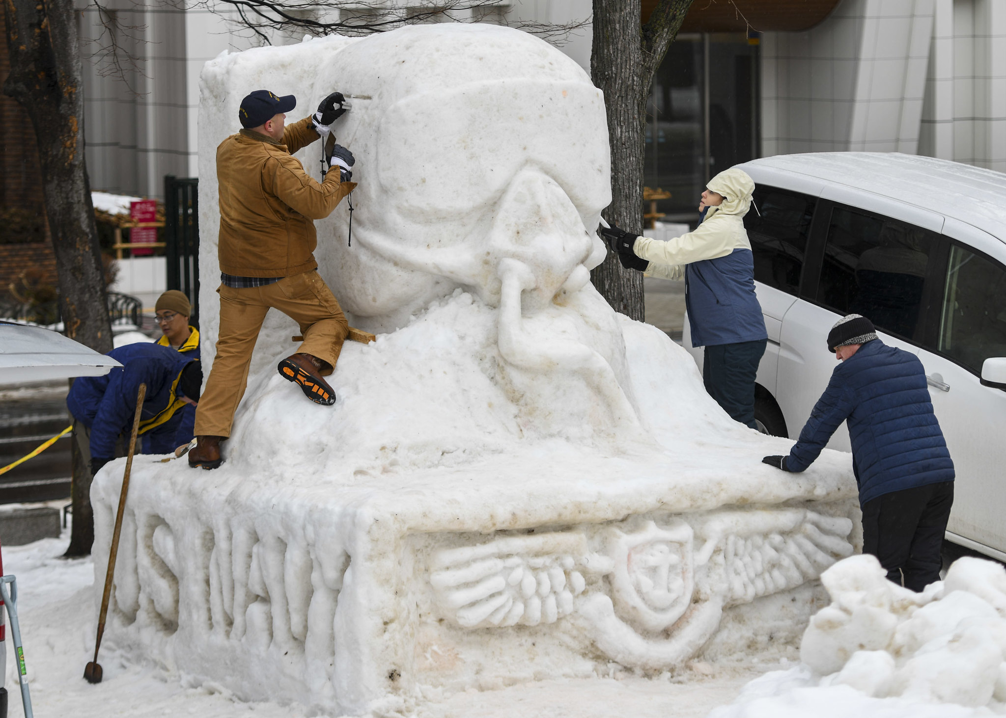 Sailors from Naval Air Facility Misawa, Japan, and tenant commands sculpt a snow statue Jan. 30, 2020, during the 71st annual Sapporo Snow Festival. (Mass Communication Specialist 3rd Class Jan David De Luna Mercado/Navy)