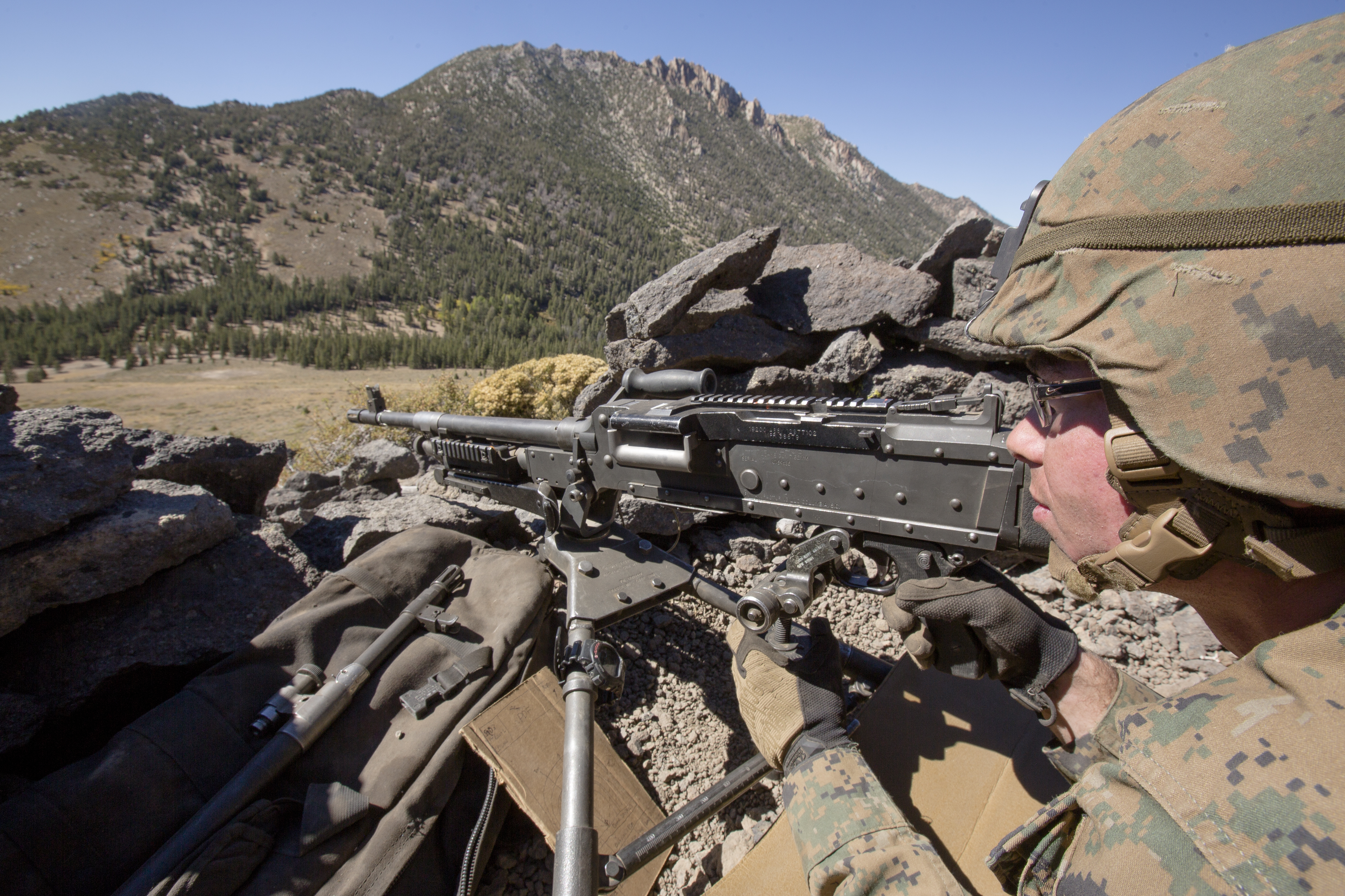 A Marine with Weapons Company, 1st Battalion, 6th Marine Regiment, 2nd Marine Division, provides security at an observation post located at landing zone mean peak during the last field exercise of Mountain Exercise 5-15, Marine Corps Mountain Warfare Training Center, Bridgeport, California, Sept. 23, 2015. (Cpl. Kelly L. Street/Marine Corps)