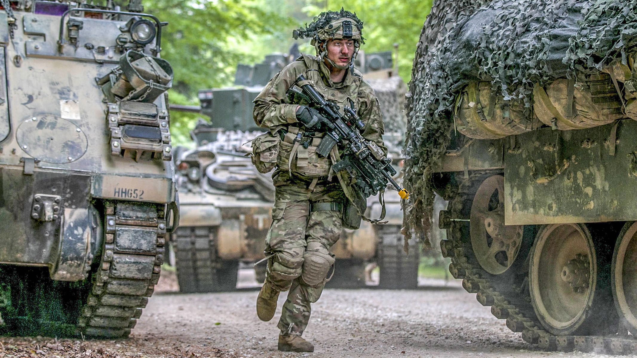 A Soldier assigned to 1st Battalion, 63rd Armor Regiment, 2nd Armored Brigade Combat Team, 1st Infantry Division, Fort Riley, Kansas, dismounts from a M2 Bradley fighting vehicle and rushes towards his defensive position during Combined Resolve X in Hohenfels Training Area, Germany, May 2, 2018. Exercise Combined Resolve X is an U.S. Army Europe exercise series held twice a year in southeastern Germany to prepare forces in Europe to work together to promote stability and security in the region. (Spc. Dustin D. Biven / Army)