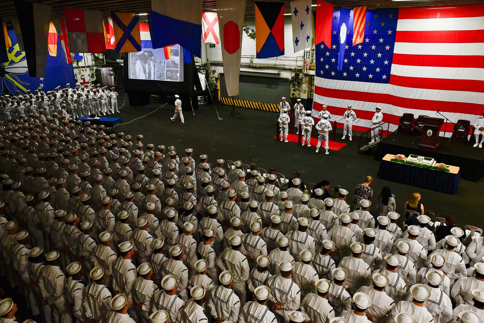 Sailors stand at parade rest during a change-of-command ceremony aboard the amphibious assaut ship USS Wasp (LHD 1) on April 13, 2019, at Subic Bay, Philippines. (Mass Communication Specialist 3rd Class Benjamin F. Davella III/Navy)