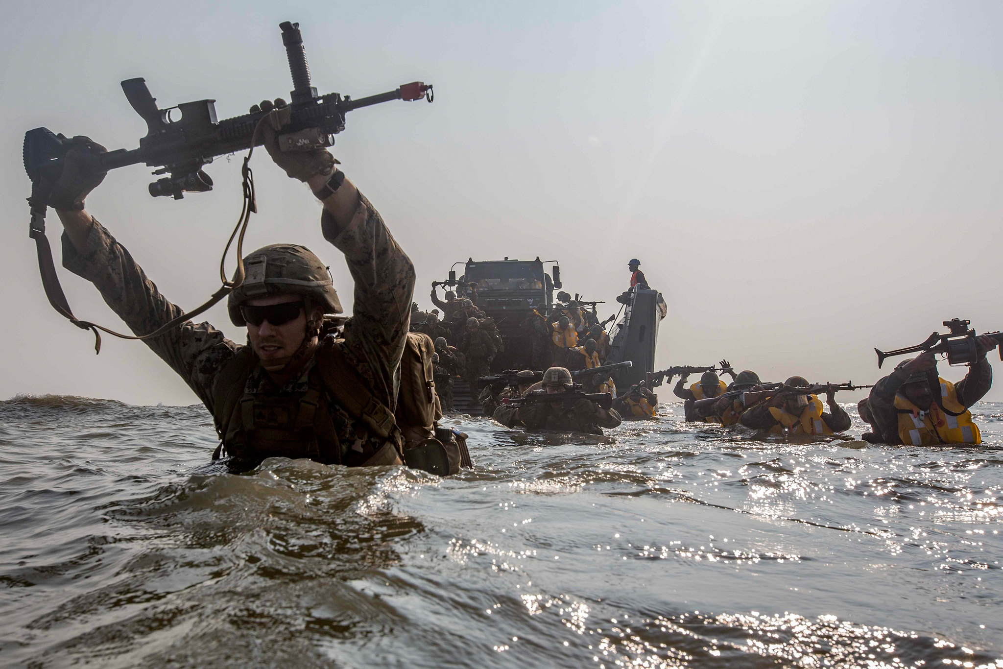 U.S. Marines and members of the Indian military wade to shore Nov. 19, 2019, during exercise Tiger TRIUMPH on Kakinada Beach, India. (Lance Cpl. Christian Ayers/Marine Corps)