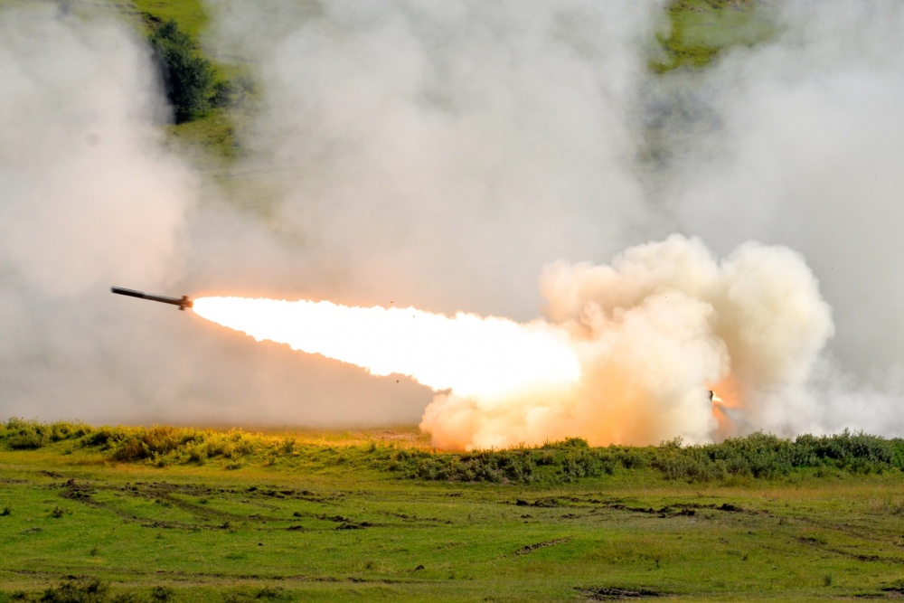Soldiers assigned to the 5th Battalion, 113th Field Artillery Regiment (High Mobility Artillery Rocket System), fire a M142 HIMARS light multiple rocket launcher during a live fire exercise at a training area near Cincu, Romania, during Exercise Guardian Saber, July 9 - 11, 2017. (Photo by Sgt. Odaliska Almonte/North Carolina National Guard)