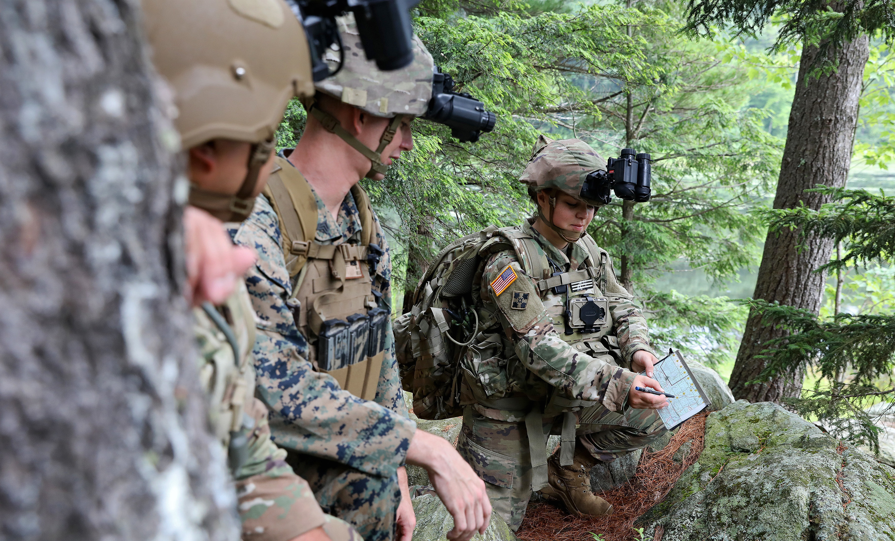 Sgt. Gabrielle Hurd, 237th Military Police Company, New Hampshire Army National Guard, shows her team the route they will take during an Enhanced Night Vision Goggle-Binocular Soldier Touchpoint, July 10-12, 2019. The Adaptive Squad Architecture device being developed by Program Executive Office Soldier will power and share data with gear such as the ENVG-B. (Army)
