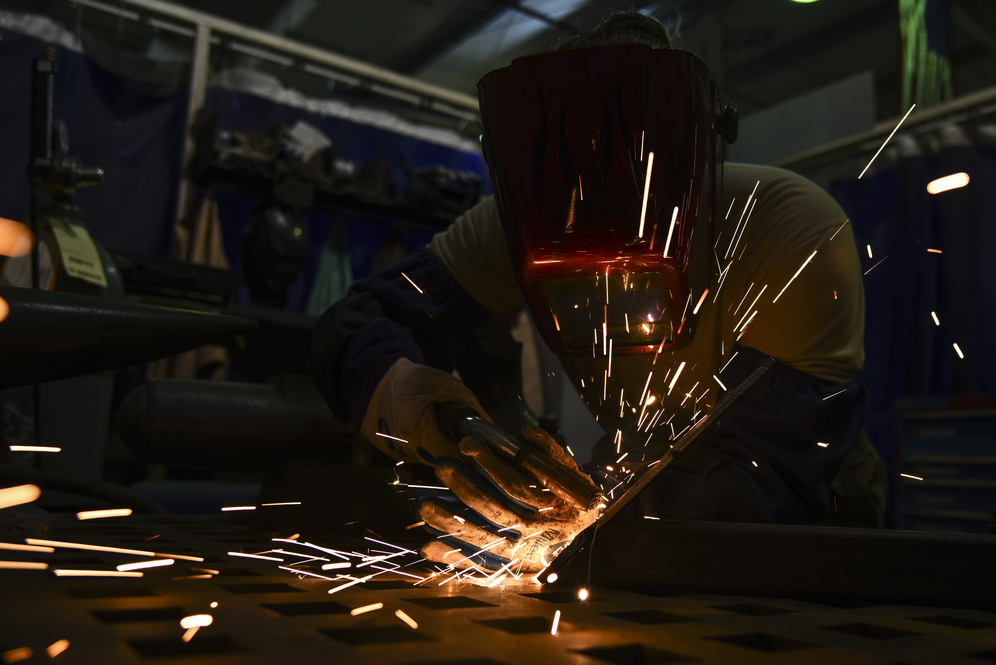 Senior Airman Courtnee Grafton, 380th Expeditionary Maintenance Squadron metal technician, welds a piece of metal at Al Dhafra Air Base, United Arab Emirates, Dec. 9, 2018. The 380th EMXS fabrication flight is in charge of identifying and repairing aircraft structural damage. (Senior Airman Mya M. Crosby/Air Force)