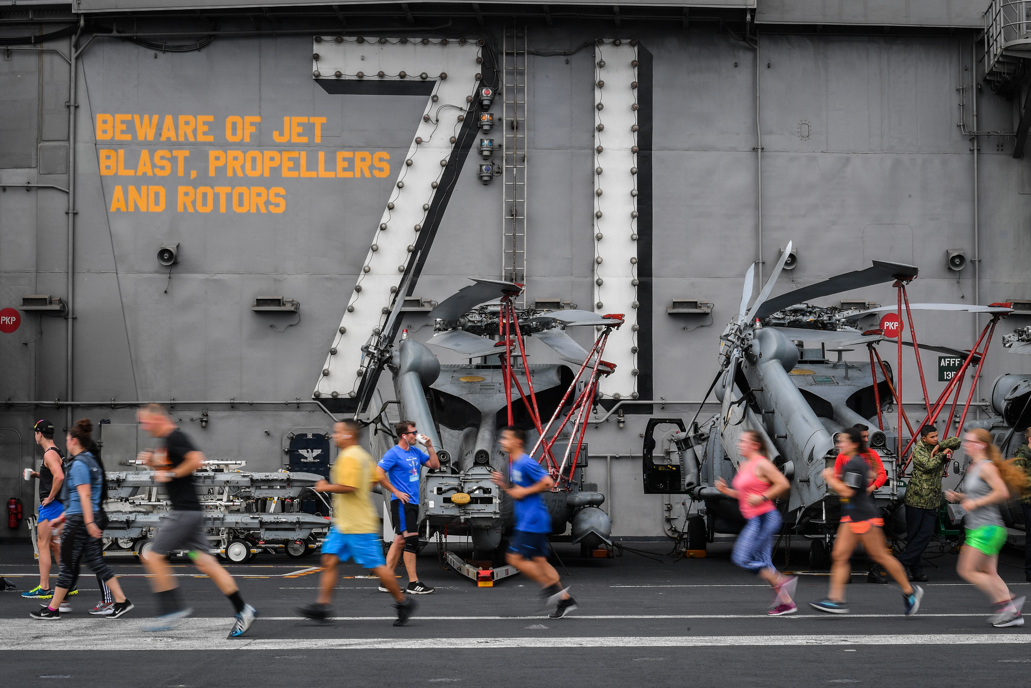 Sailors run during a Summer Sun 5K on the flight deck of the aircraft carrier USS Theodore Roosevelt (CVN 71) on July 21, 2019. (Mass Communication Specialist Seaman OIympia O. McCoy/Navy)