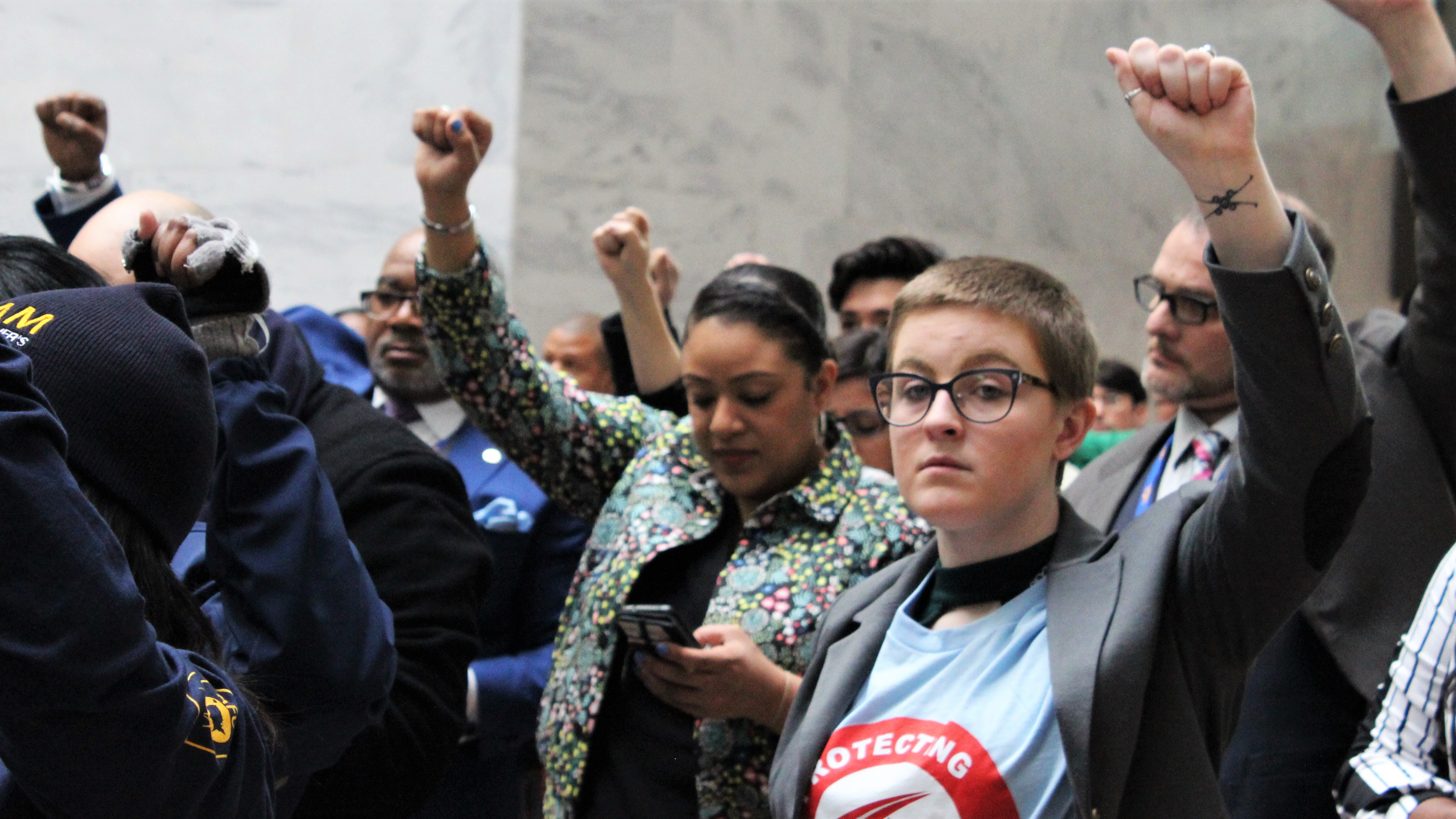 Members of the American Federation of Government Employees stood in 35 minutes of silence in the halls of the Hart Senate Office Building to protest any potential future government shutdowns. (Jessie Bur/Staff)