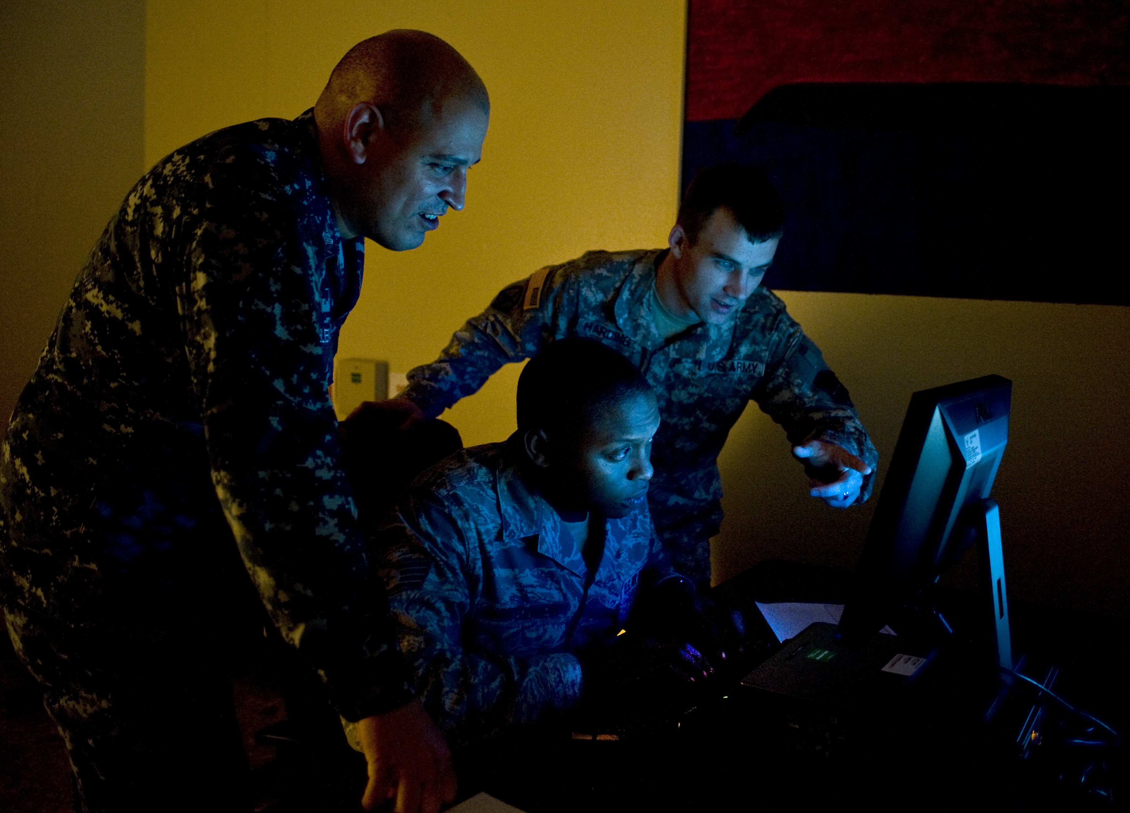 U.S. Navy Petty Officer 1st Class Joel Melendez, Naval Network Warfare Command information systems analysis, U.S. Air Force Staff Sgt. Rogerick Montgomery, U.S. Cyber Command network analysis, and U.S. Army Staff Sgt. Jacob Harding, 780th Military Intelligence Brigade cyber systems analysis, analyze an exercise scenario during Cyber Flag 13-1, Nov. 8, 2012, at Nellis Air Force Base, Nev. (Senior Airman Matthew Lancaster/Air Force)