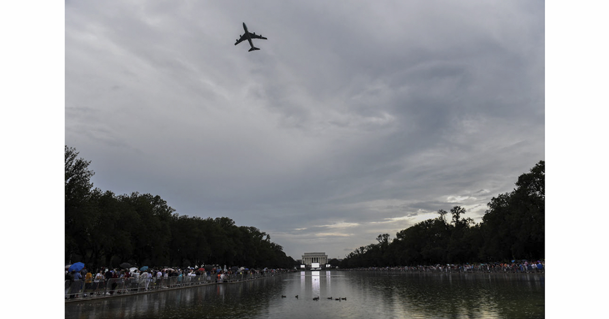 Air Force one flies over the National Mall ahead of President Trump's speech during Fourth of July festivities on July 4, 2019 in Washington, DC. President Trump is holding a