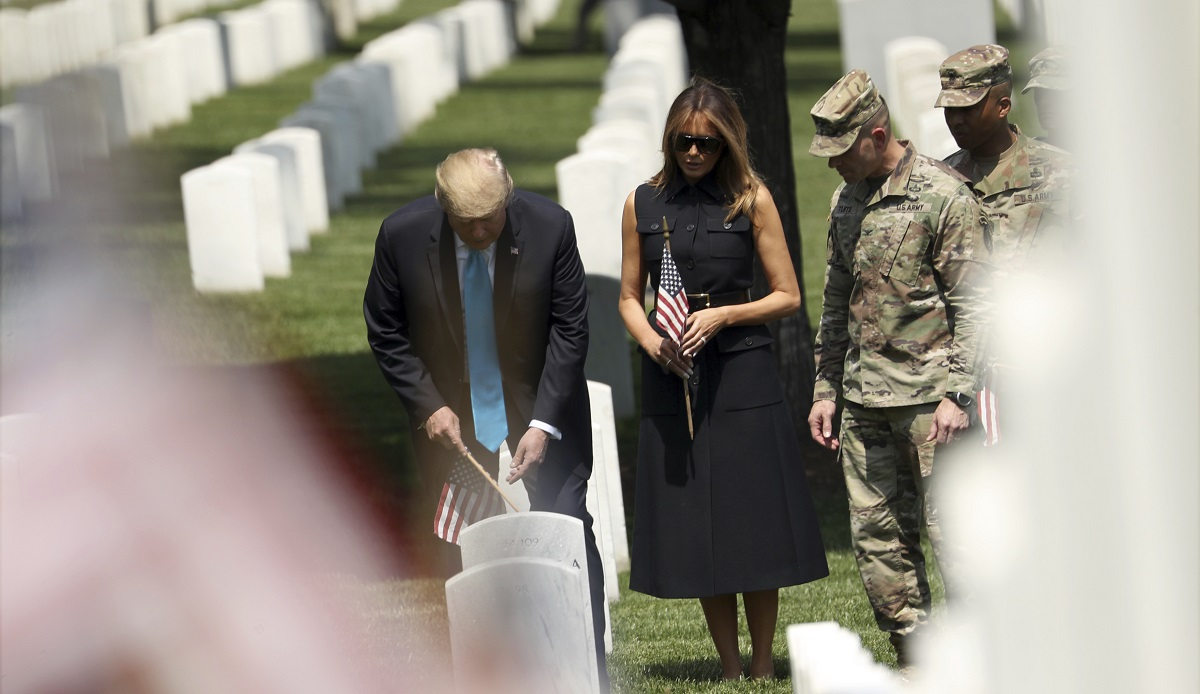 President Donald Trump and first lady Melania Trump visit Arlington National Cemetery for the annual Flags In ceremony ahead of Memorial Day Thursday, May 23, in Arlington, Virginia. (Andrew Harnik/AP)