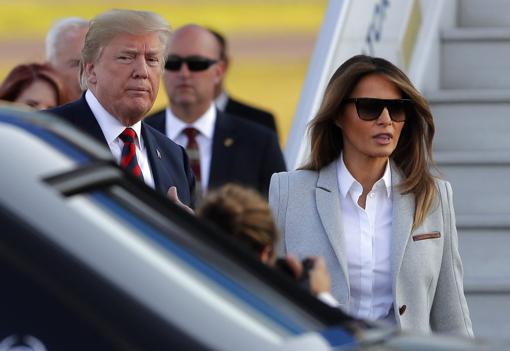 U.S. President Donald Trump, left, and first lady Melania Trump arrive at the airport in Helsinki, Finland, Sunday, July 15, 2018 on the eve of his meeting with Russian President Vladimir Putin. (Markus Schreiber/AP)