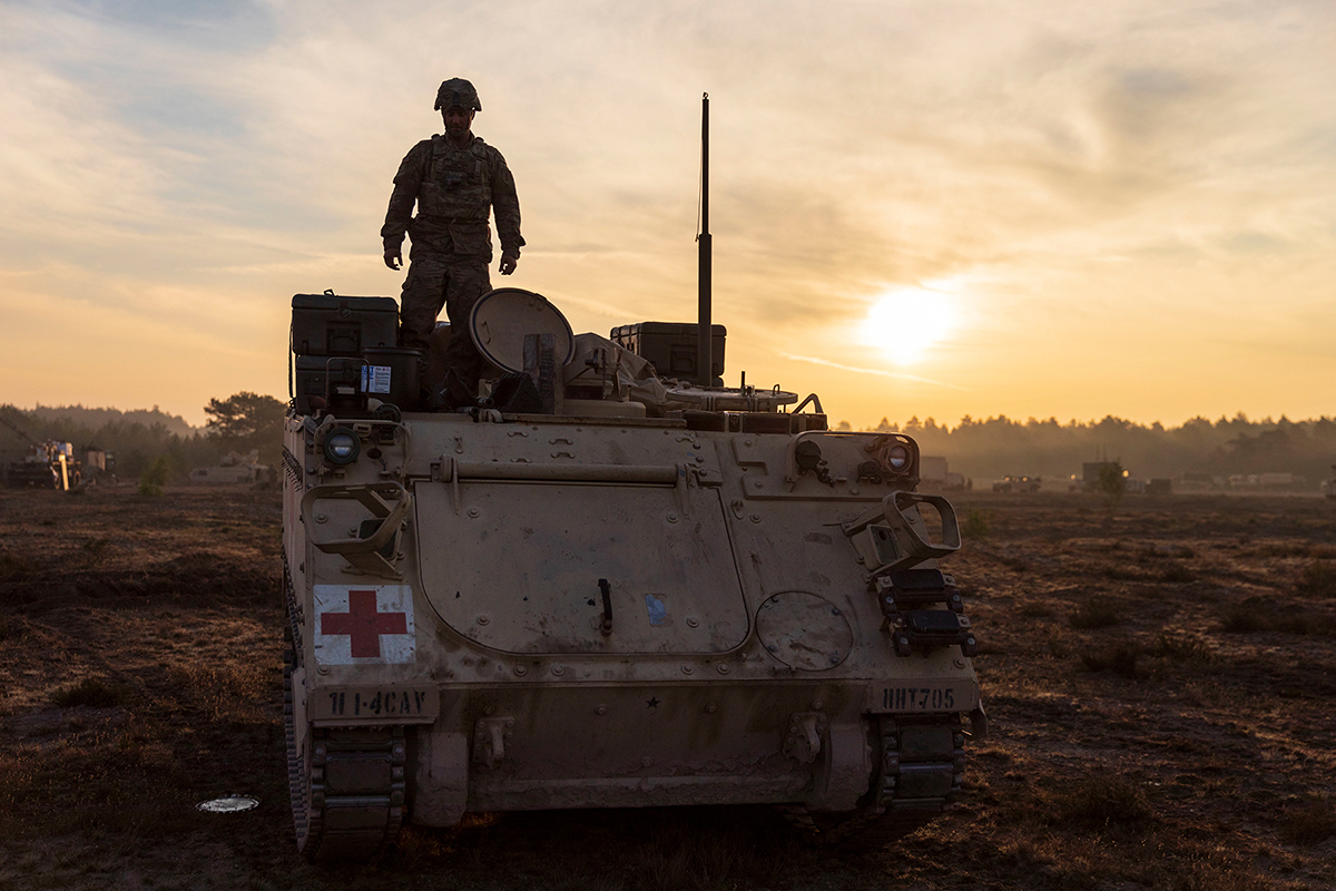 A soldier prepares an M113 armored personnel carrier for a convoy during a rapid-deployment exercise at Johanna Range, Poland, May 20, 2019. (Sgt. Thomas Mort/Army)