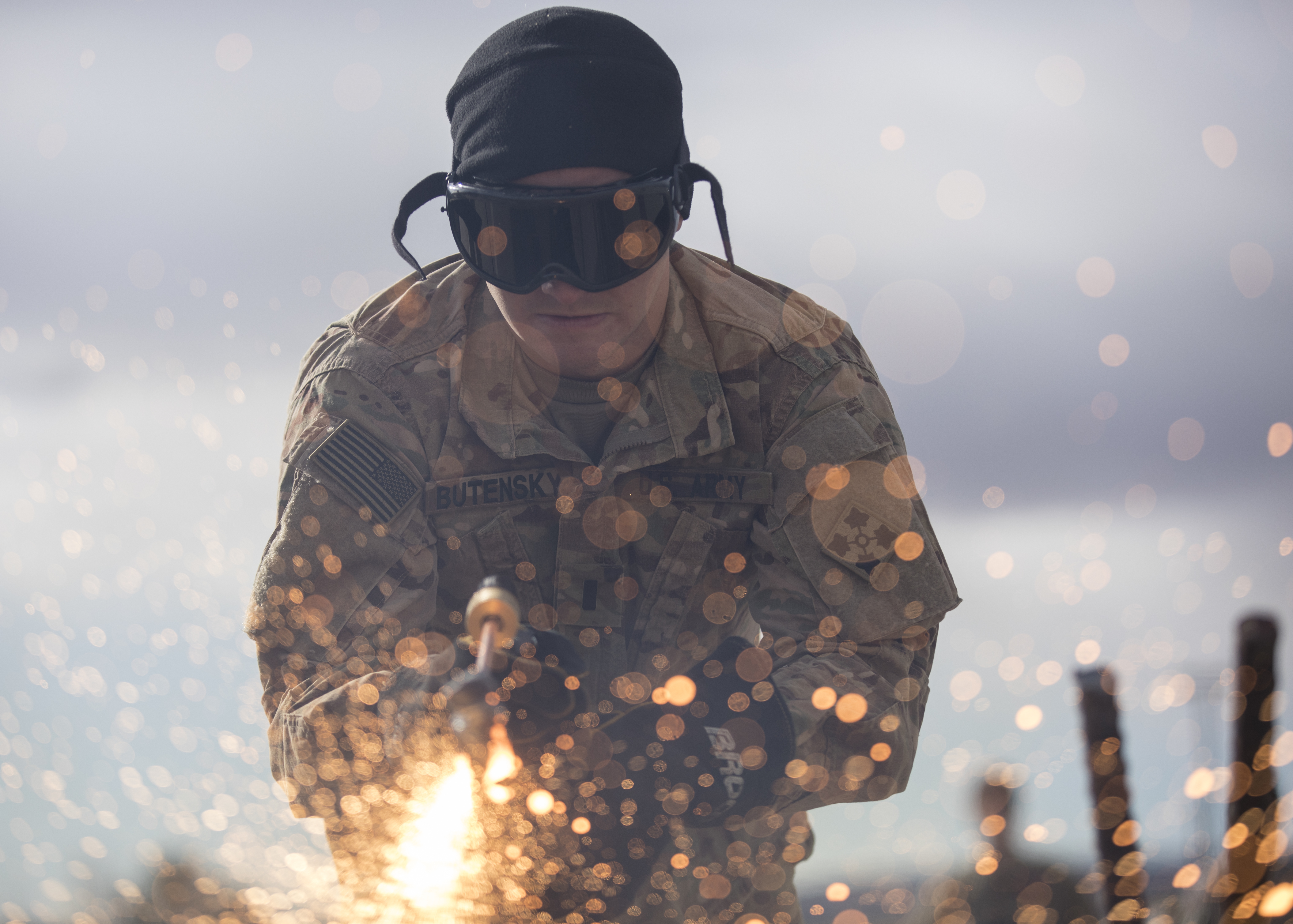 1st Lt. Daniel Butensky, an engineer officer assigned to 299th Brigade Engineer Battalion, 1st Stryker Brigade Combat Team, 4th Infantry Division, cuts through metal with a Broco torch in sub-freezing temperatures during the Best Sapper Competition, Fort Carson, Colorado, December, 6, 2017. U. S. Army photo by Sgt. Micah Merrill