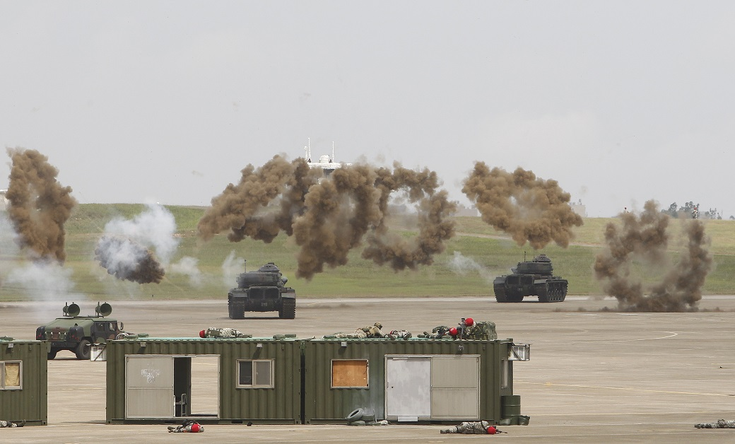 Preparing for the possibility of hostilities, tanks from Taiwan's military take part in the annual Han Kuang exercises at an air base in Taichung County, Taiwan, on June 7, 2018. (Chiang Ying-ying/AP)