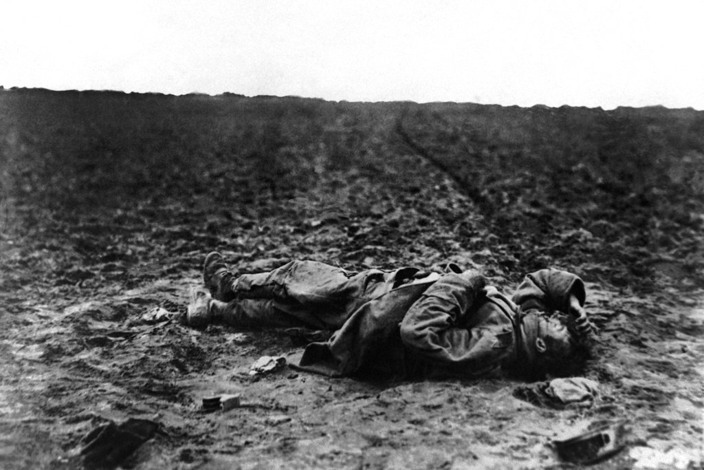 A lone wounded Austrian soldier lies on the field of battle during World War I. (AP)