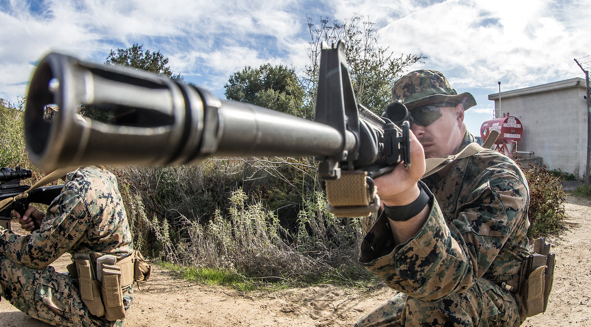 Lance Cpl. Mitchell Smith sights in on a barrel at the 1st Maintenance Battalion Marksmanship Trainer Unit on Marine Corps Base Camp Pendleton, Calif., Jan. 7, 2020. (Lance Cpl. Alison Dostie/Marine Corps)