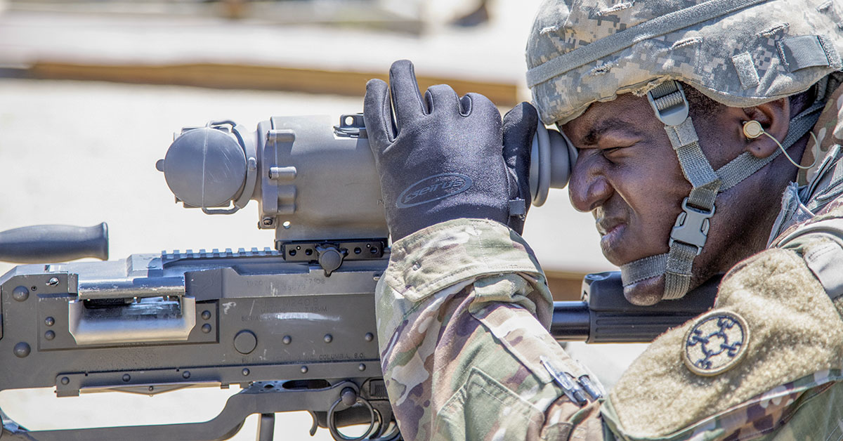 Army Reserve Spc. Chester Bannis, assigned to Task Force Ultimate adjusts his thermal optic during crew-served weapon familiarization training during Operation Cold Steel II, in preparation for the arrival of troop list units, Fort Dix, N.J., June 30, 2018. (Sgt. Tracy McKithern/Army)