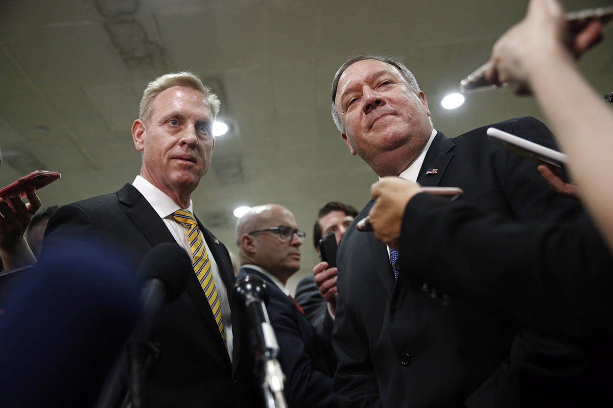Acting Defense Secretary Patrick Shanahan, left, and Secretary of State Mike Pompeo speak to members of the media after a classified briefing for members of Congress on Iran, Tuesday, May 21, 2019, on Capitol Hill in Washington. (Patrick Semansky/AP)