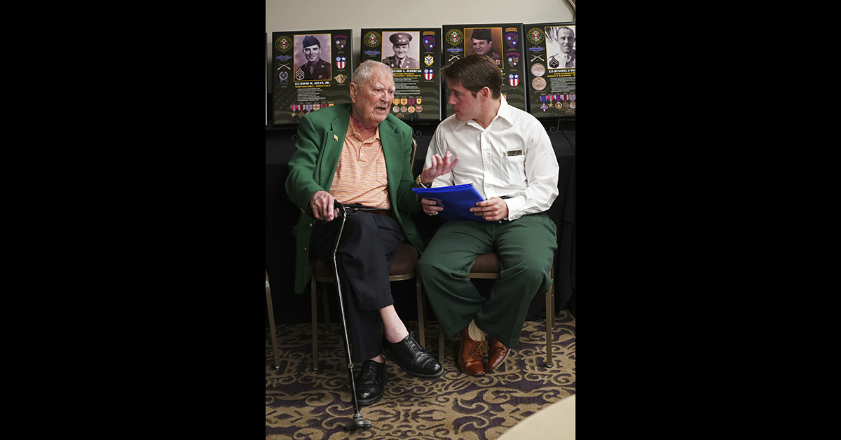 David Allan, of Rockhill SC, left, a surviving members of the famed WWII Army unit Merrill's Marauders talks with Britt Fuller, of Tallahassee Fla., whose grandfather Lonzie Whitfield was a member of the unit, during a gathering of remaining members, family and history buffs, in New Orleans, Tuesday, Aug. 28, 2018. (Gerald Herbert/AP)