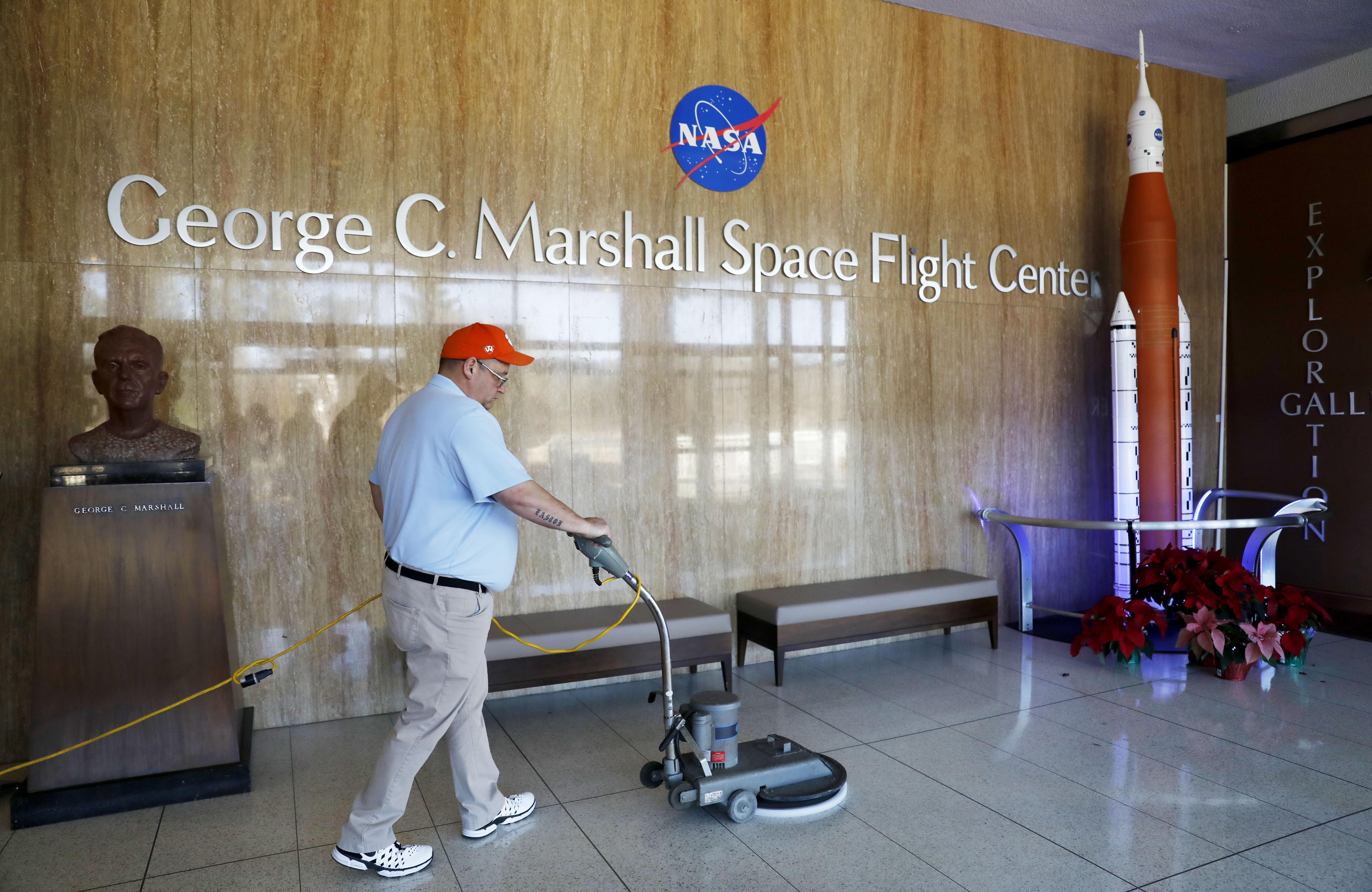 A worker cleans the floors at NASA's Marshall Space Flight Center, which has been impacted by the partial federal government shutdown at the Army's Redstone Arsenal in Huntsville, Ala., Wednesday, Jan. 9, 2019. Located at the base of a mountain in the lush Tennessee Valley, Huntsville was just another Alabama city until the government decided to build rockets at Redstone Arsenal at the dawn of the space race. (David Goldman/AP)