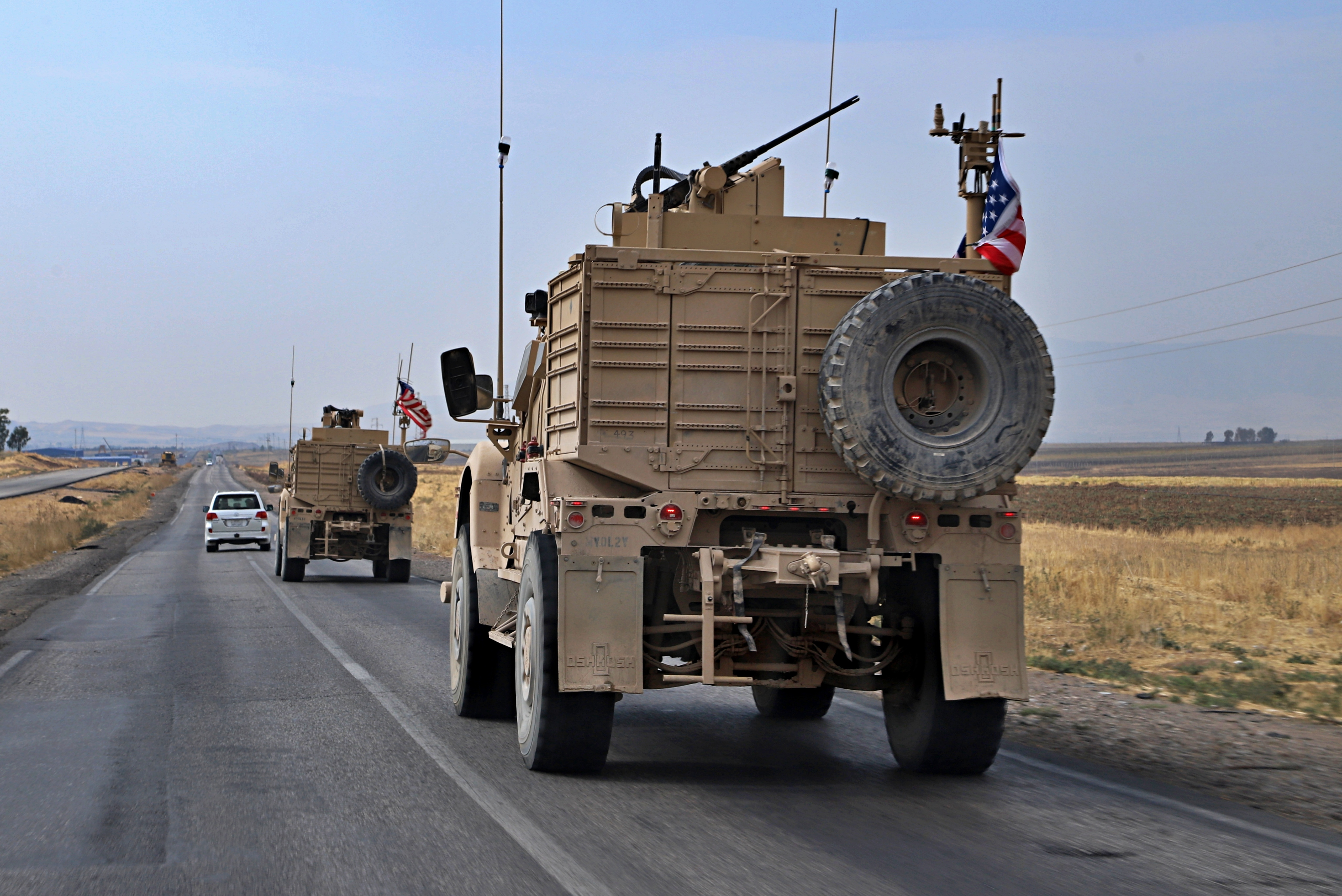 A U.S. military convoy arrives near Dahuk, Iraq, on Monday, Oct. 21, 2019. Defense Secretary Mark Esper said Monday that under the current plan all U.S. troops leaving Syria will go to western Iraq and the military will continue to conduct operations against the Islamic State group to prevent its resurgence. (AP Photo)