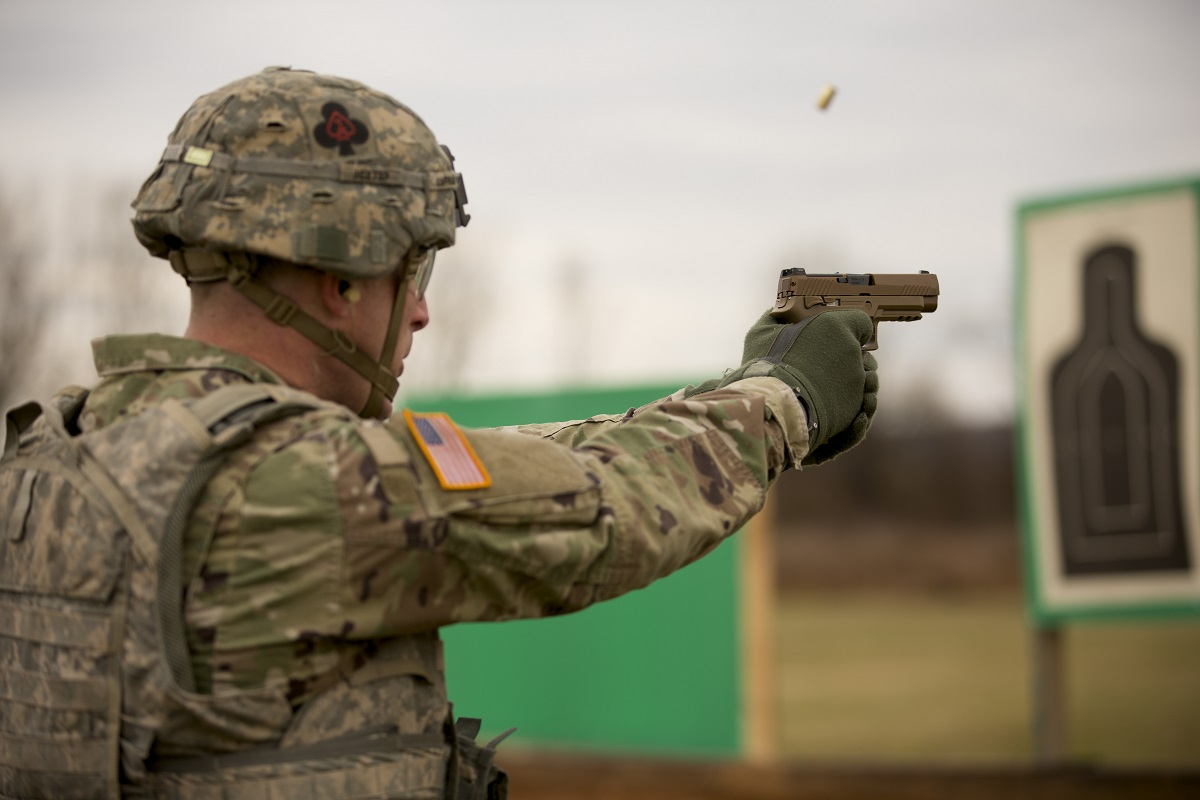 A soldier in the 101st Airborne Division fires the new Modular Handgun System, or M17, at Fort Campbell, Ky. This new handgun, made by Sig Sauer, will replace the Army's Beretta M9. (Daniel Woolfolk/Staff)