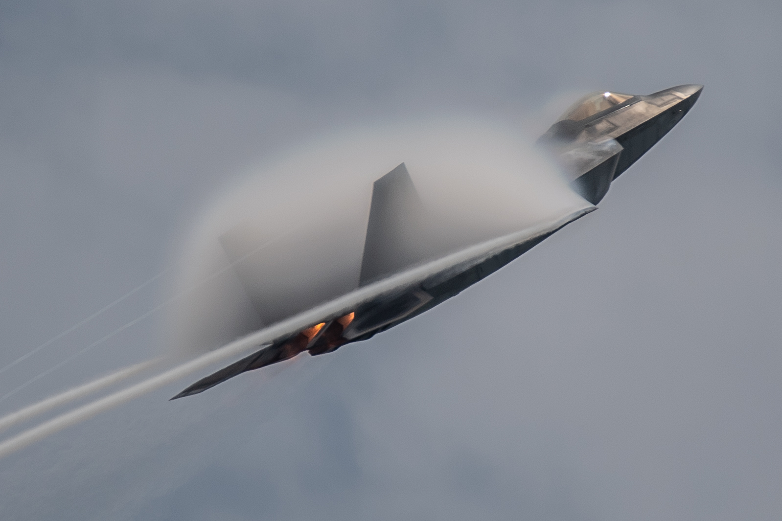 Maj. Josh Gunderson, F-22 Demonstration Team pilot, performs during an aerial demonstration at the Singapore Airshow 2020 near the Changi Exhibition Center, Feb. 11, 2020. (2nd Lt. Sam Eckholm/Air Force)