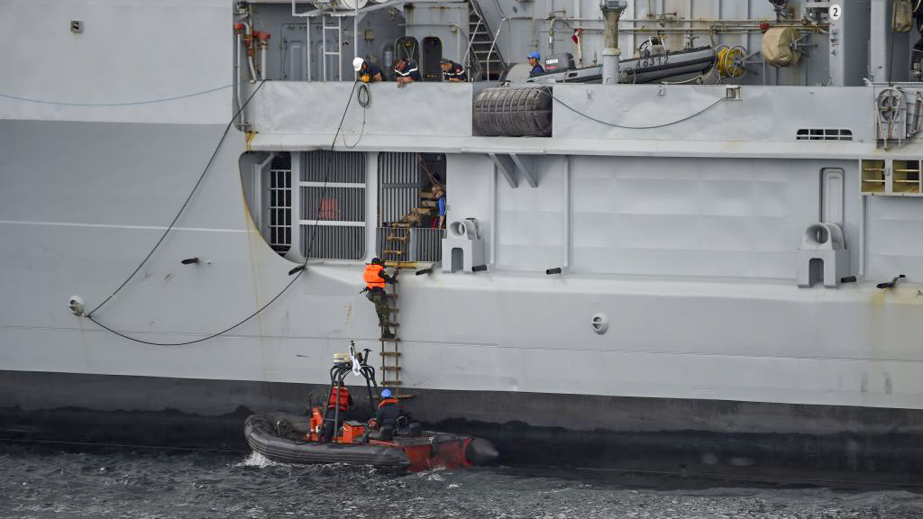 The Nigerian navy Special forces climb French logistics vessel to apprehend pirates in a stage managed operations during the five-day joint military exercise between Nigeria and French navy codenamed Grand African NEMO (Navy Exercise Maritime Operations) in Nigerian waters on October 30, 2019. - The Nigerian Navy has participated in a five-day multinational military exercise codenamed Grand African NEMO (Navy Exercise Maritime Operations), and with a joint naval drills with the French counterpart designed to support regional navies and allied nations to check criminal activities and perfect strategies in tackling maritime crimes in the Gulf of Guinea. (Photo by PIUS UTOMI EKPEI / AFP) (Photo by PIUS UTOMI EKPEI/AFP via Getty Images)