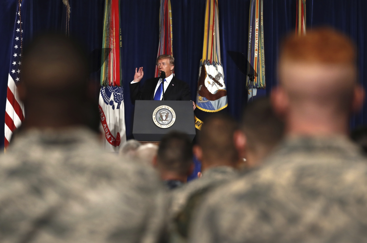 President Donald Trump speaks at Fort Myer in Arlington Va., Monday, Aug. 21, 2017, during an address to the nation about a strategy he believes will best position the U.S. to eventually declare victory in Afghanistan. (Carolyn Kaster/AP)