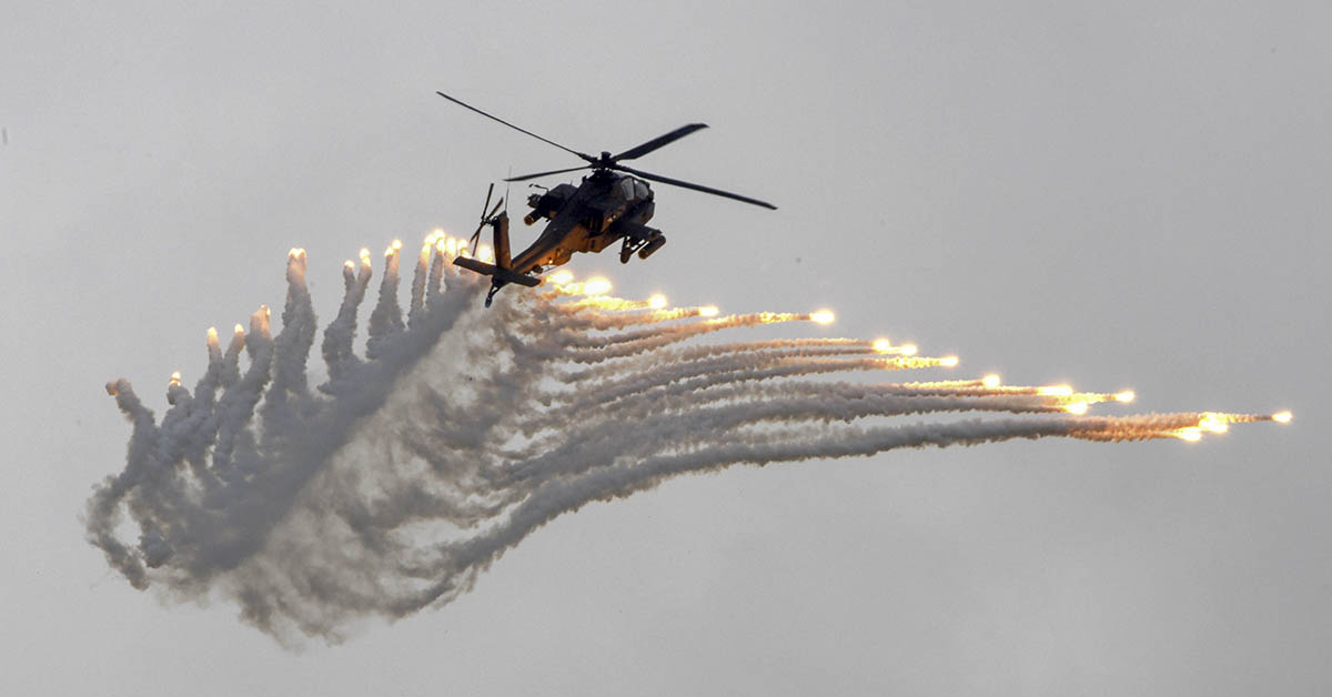 An AH-64 Apache attack helicopter releases flares during the Han Kuang drill in Taichung, central Taiwan, on June 7, 2018. (Sam Yeh/AFP via Getty Images)