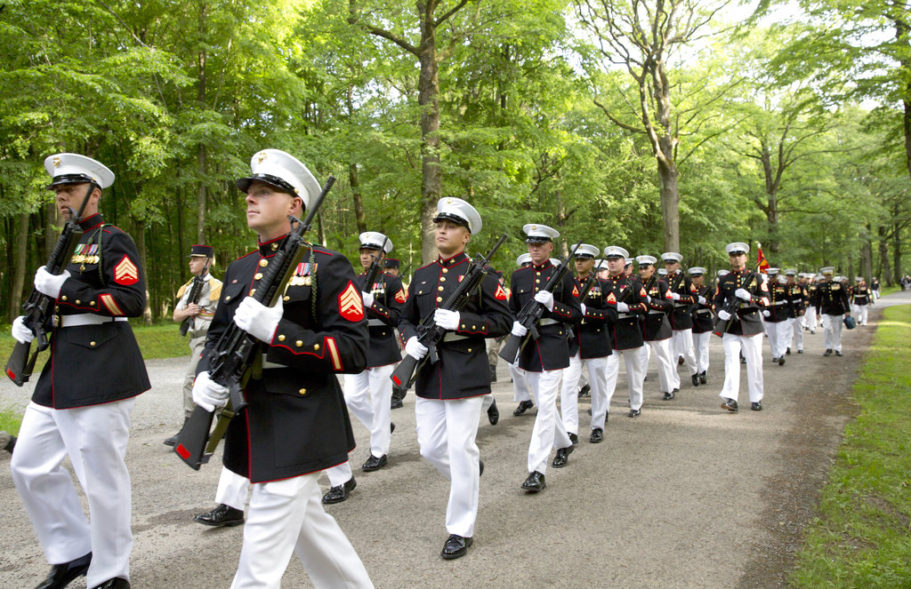 U.S. Marines march through the battlefield of Belleau Wood prior to a Memorial Day commemoration at the Aisne-Marne American Cemetery in Belleau, France, Sunday, May 27, 2018. The cemetery contains more that 2,000 American dead. (Virginia Mayo/AP)