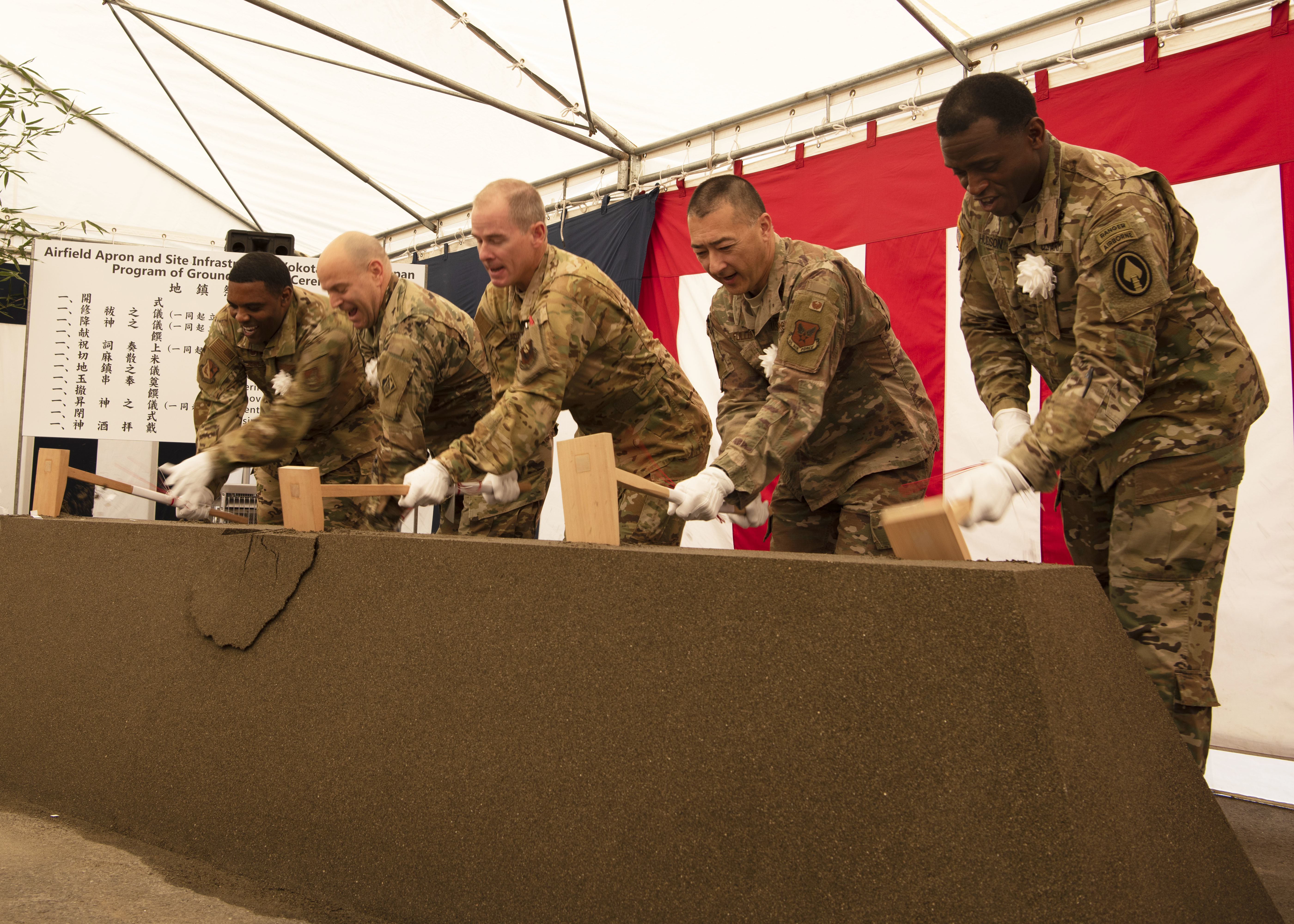 Air Force and Army partners overseeing the construction of the Air Force Special Operations Command airfield apron break ground at a ceremony held at Yokota Air Base, Japan, Dec. 5, 2019. The AFSOC complex will provide the 21st Special Operations Squadron a permanent home for the CV-22 Osprey as a new apron is added to the existing airfield pavements as well as new utility and communication infrastructure. (Staff Sgt. Taylor Workman)