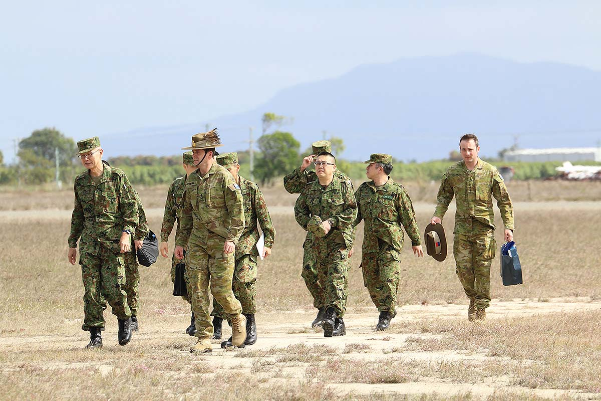 Lt. Gen. Takayuki Onozuka, vice chief of the Japan Ground Self-Defense Force, and Deputy Chief of the Australian Army Maj. Gen. Anthony Rawlins arrive in Bowen, Australia, on July 22, 2019. This year's exercise saw the largest Japanese contingent since it began participating in 2015, with two warships, four helicopters, several vehicles and a sizable troop contingent. (Mike Yeo/Staff)