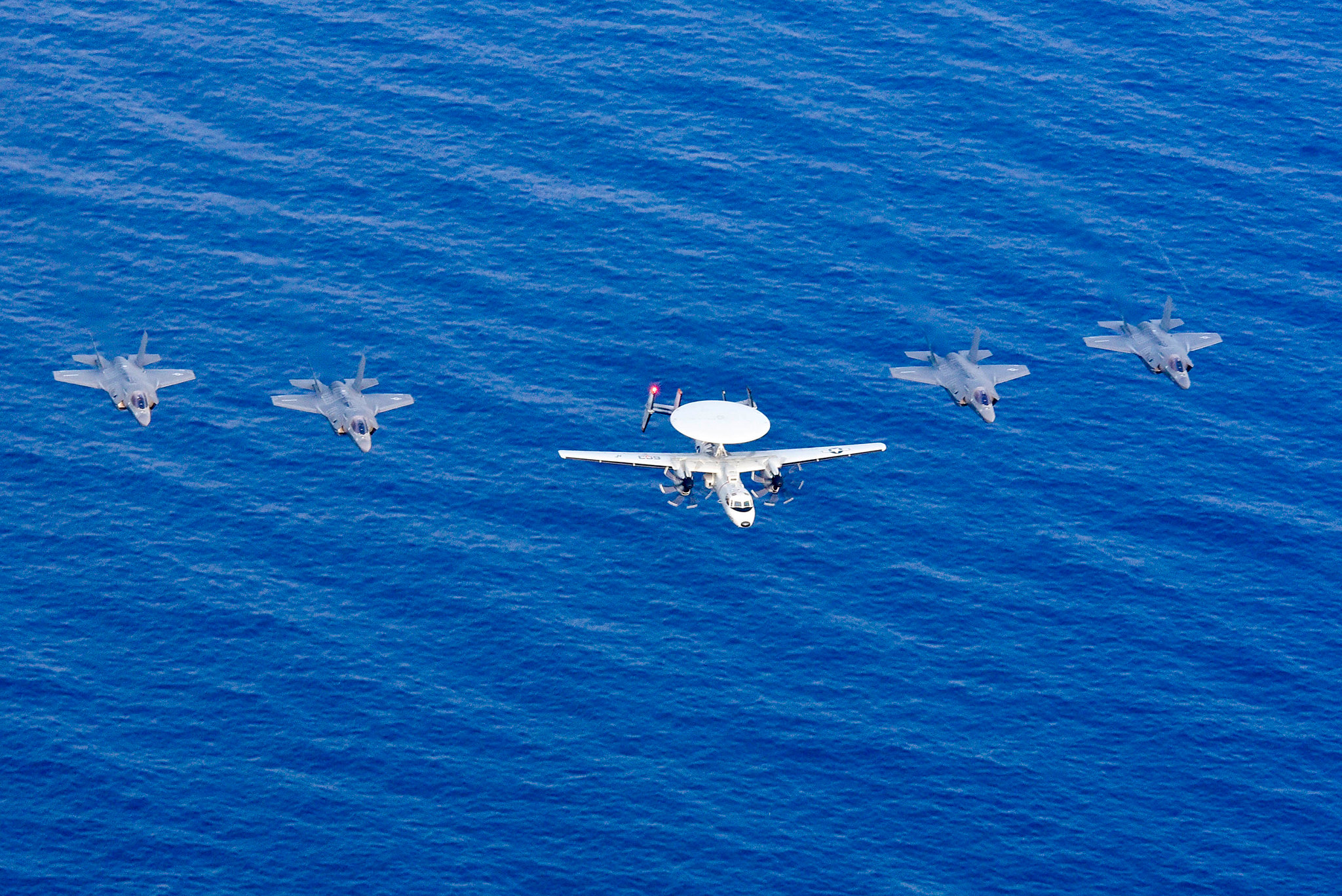 An E-2D Hawkeye and four F-35 Lightning II aircraft fly in formation April 8, 2019, after flying over the amphibious assault ship USS Wasp (LHD 1) during Exercise Balikatan 2019 in the South China Sea. (Mass Communication Specialist 3rd Class Benjamin F. Davella III/Navy)