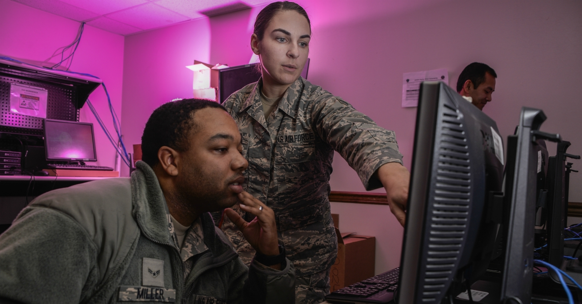 Airman 1st Class Tevin Miller and Airman 1st Class Amanda Button, 707th Communications Squadron client system technicians, update software for computers that will be used on Air Force networks January 9, 2018, at Fort George G. Meade, Maryland. The 707th CS, aligned under the 70th Intelligence, Surveillance and Reconnaissance Wing, supports more than 5,700 global personnel and 57 National Security Agency missions with their 230 'Thunder Warriors.' (Staff Sgt. Alexandre Montes/Air Force)