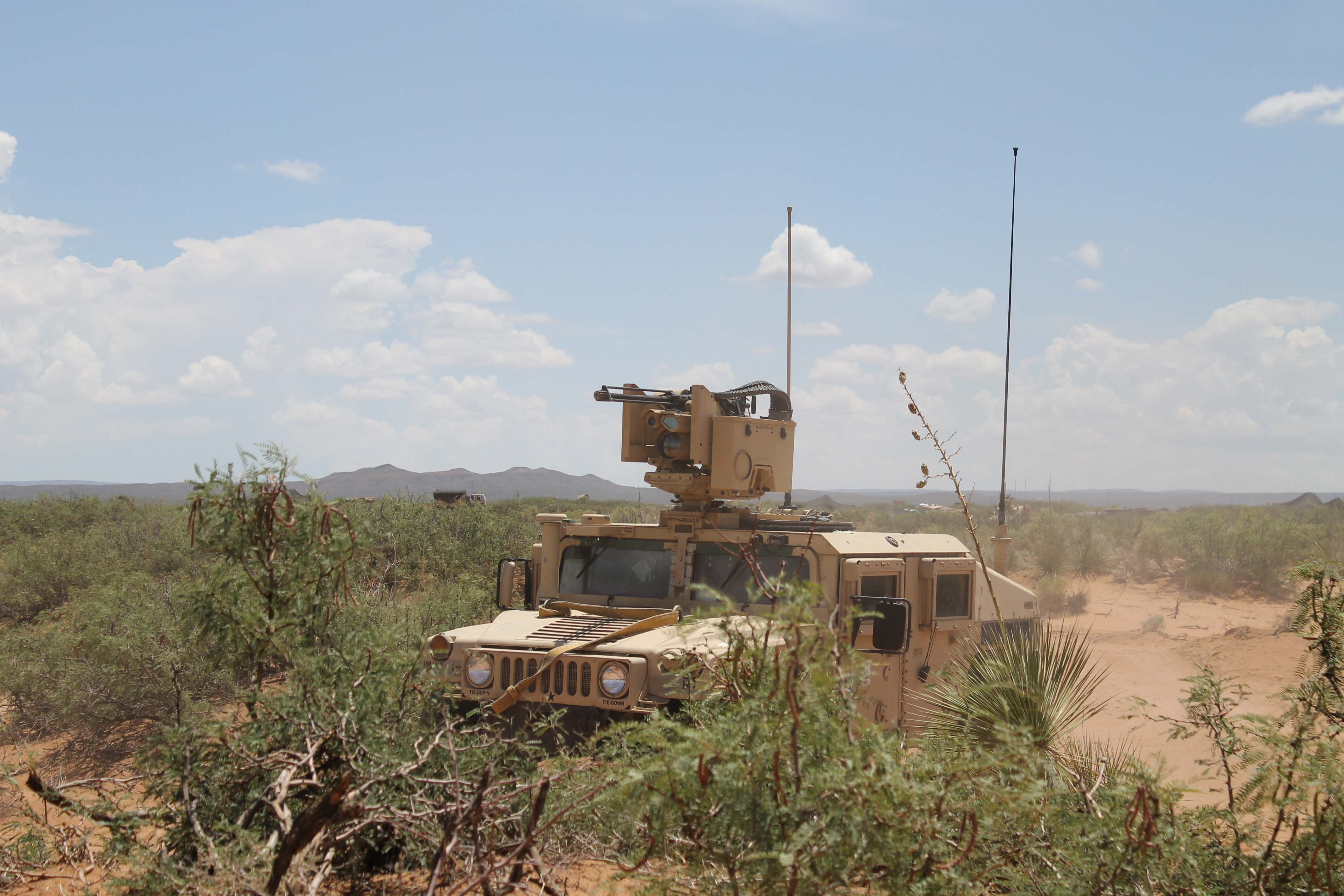 A Humvee moves position out at the NIE. Carter said he decided to put his Tactical Assault Centers (TACs) in a Humvee and move them every 15 minutes since the unit was constantly on the radio. The Humvees would be moved a few hundred meters in every direction in order to avoid location detection by the enemy, a survivability strategy in a peer and near-peer environment. (Jen Judson/Staff)