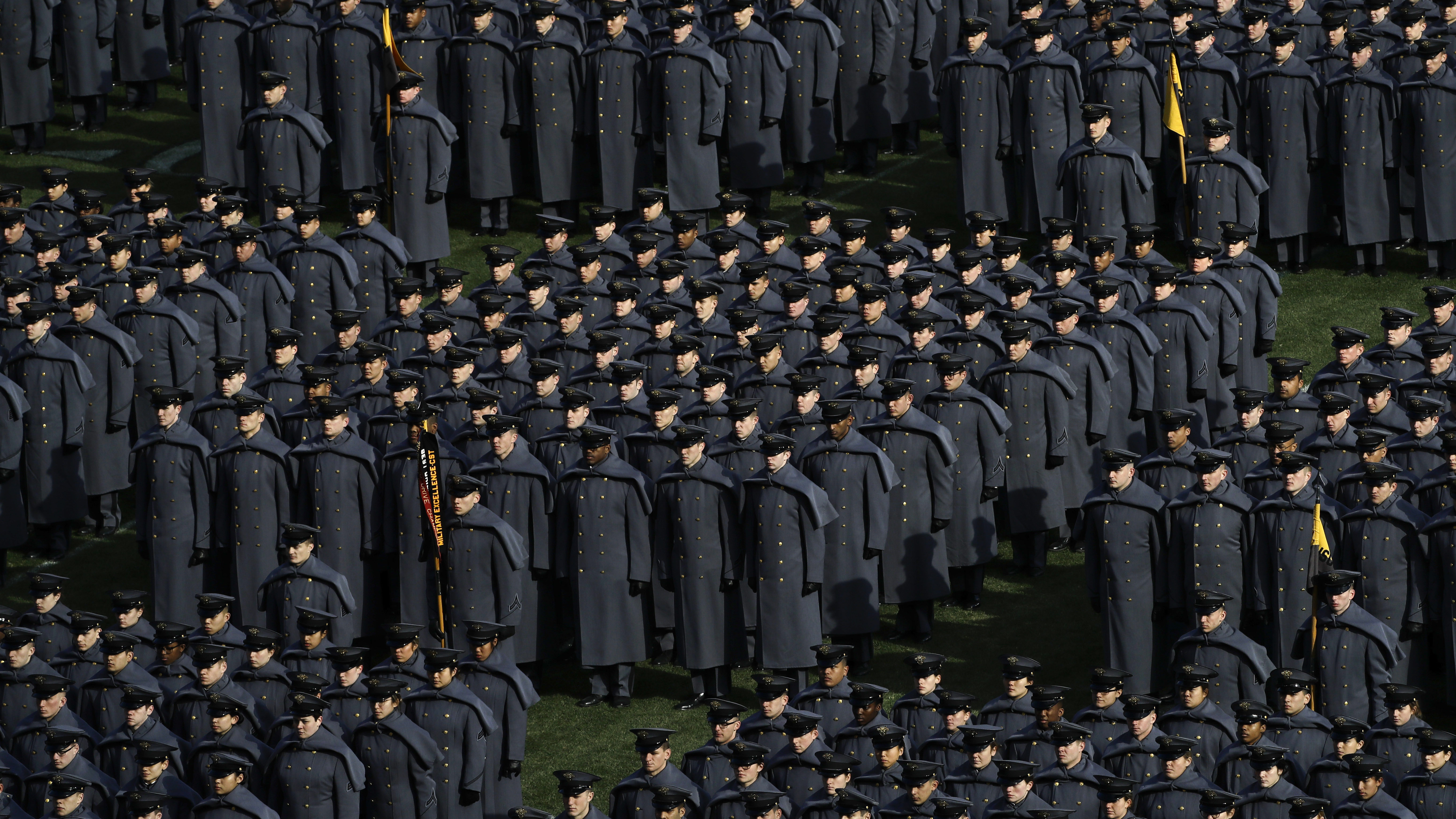 Army cadets stand at attention after marching onto the field before an NCAA college football game against Navy, Saturday, Dec. 8, 2018, in Philadelphia. (AP Photo/Matt Slocum)