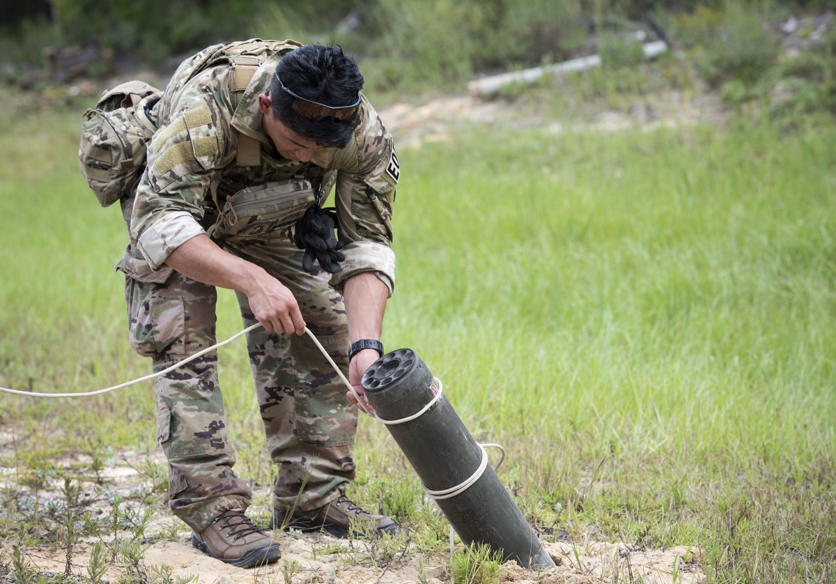 An explosive ordnance disposal Airman removes a rocket after a simulated attack during the operational phase of the beta test of the EOD Tier 2 fitness test prototype Sept. 10 at Eglin Air Force Base, Fla. The Tier 2 tests and standards were developed from EOD-specific physical requirements and the tasks they perform on operational missions. (Ilka Cole/Air Force)