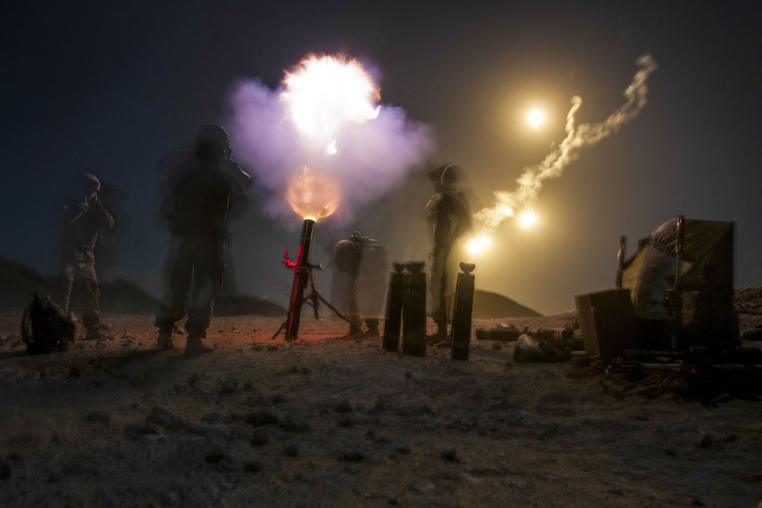 An Army mortar crew fires illumination rounds into the night near Thumrait, Oman, Jan. 28, 2018, during Inferno Creek, an annual Omani-U.S. exercise focused on building bilateral military ties. Army photo by Sgt. David L. Nye